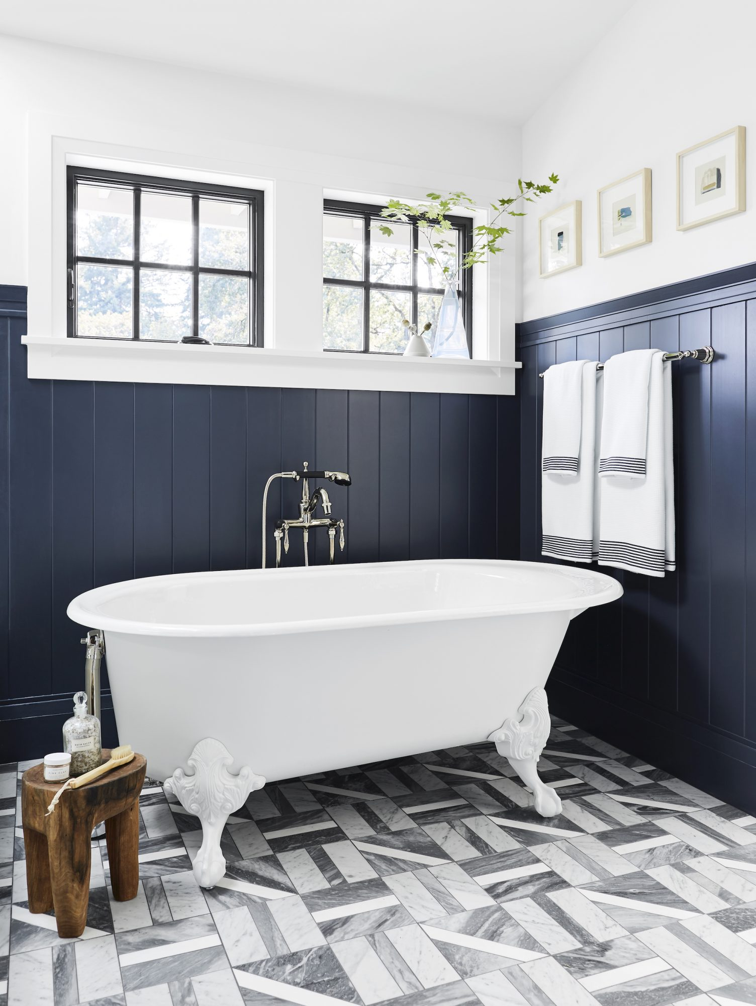 Bathroom with blue wall paneling on lower half