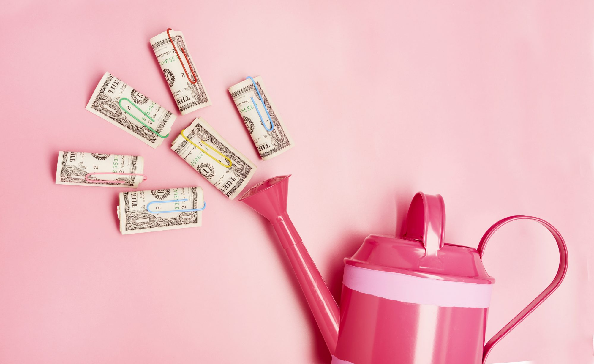 enneagram-types-spending: watering can and cash