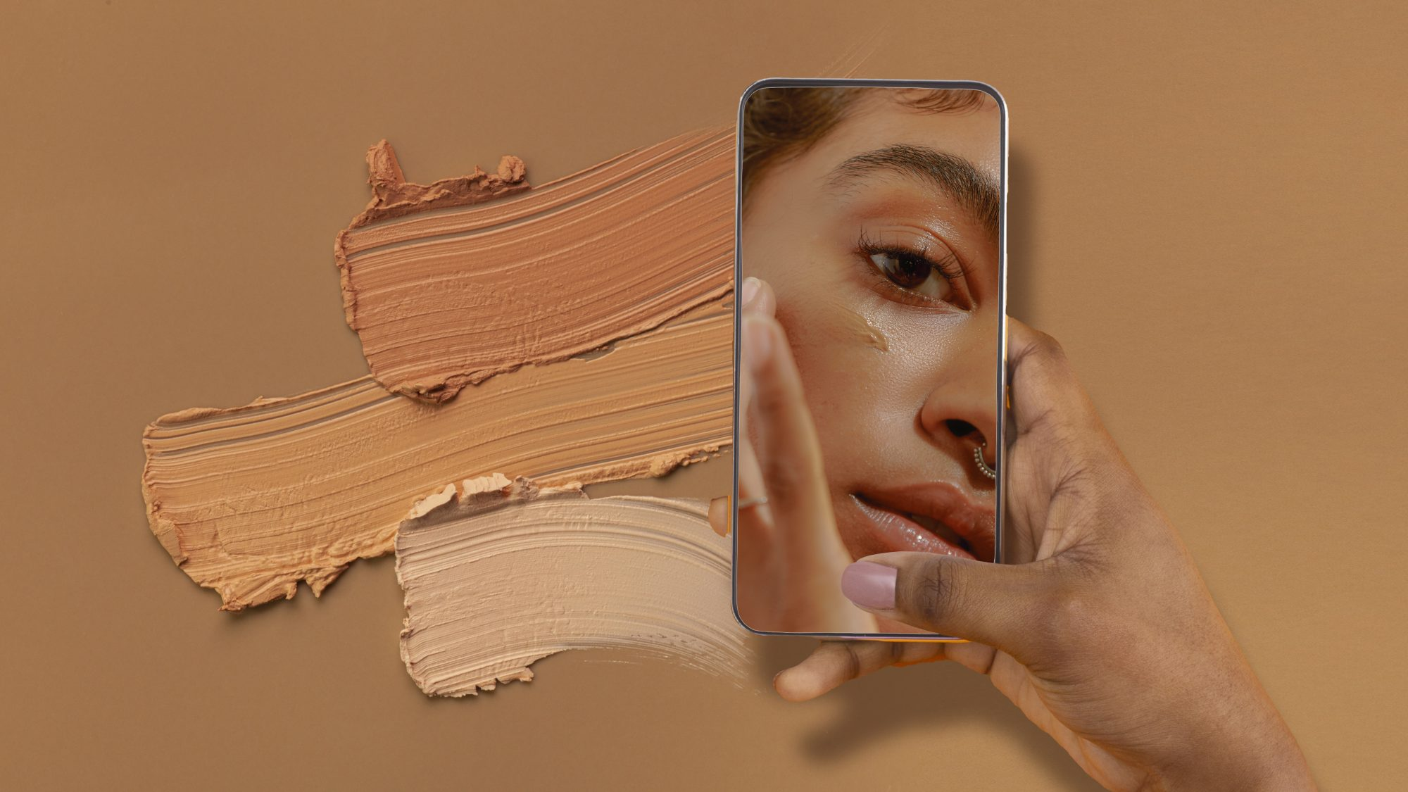 foundation-color-match: woman looking at herself on cell phone