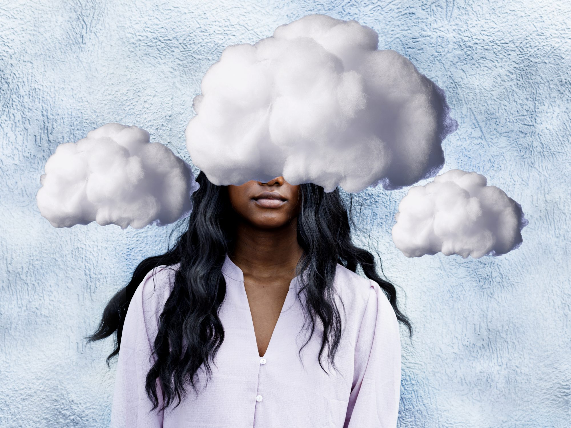 What Is Brain Fog? Brain Fog Meaning, Causes, and Fixes: clouds covering woman's face