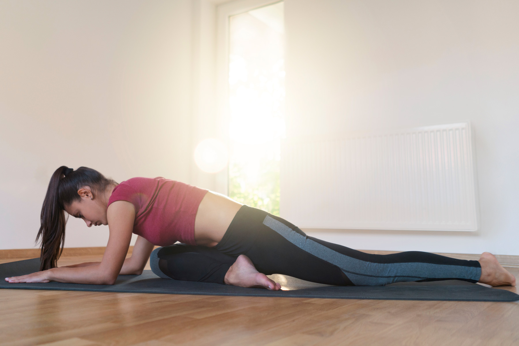 Yoga Poses to Relieve Muscle Tension: Sleeping one-leg pigeon pose hip stretch