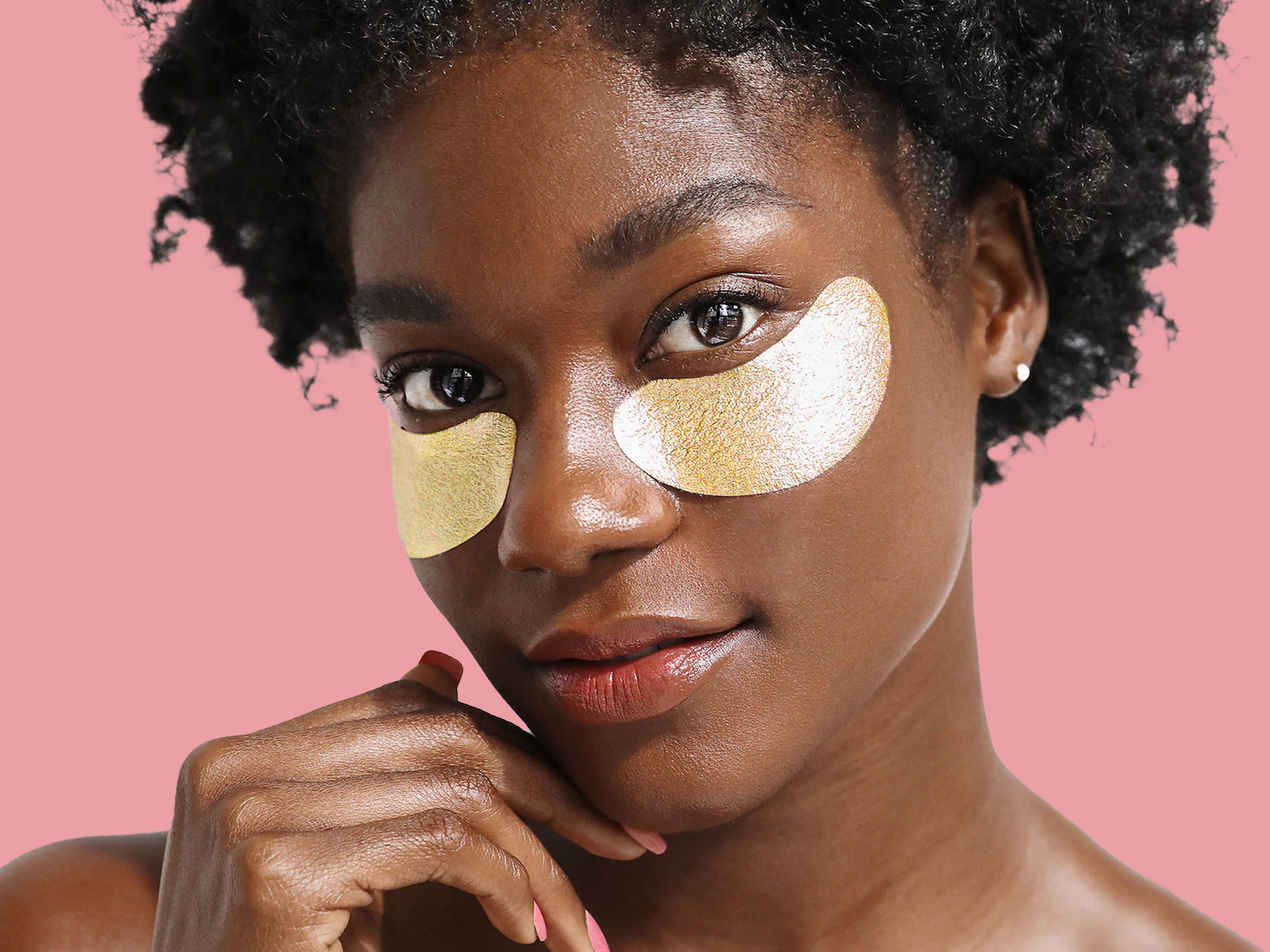 best-eye-masks: woman with gold eye masks under her eyes