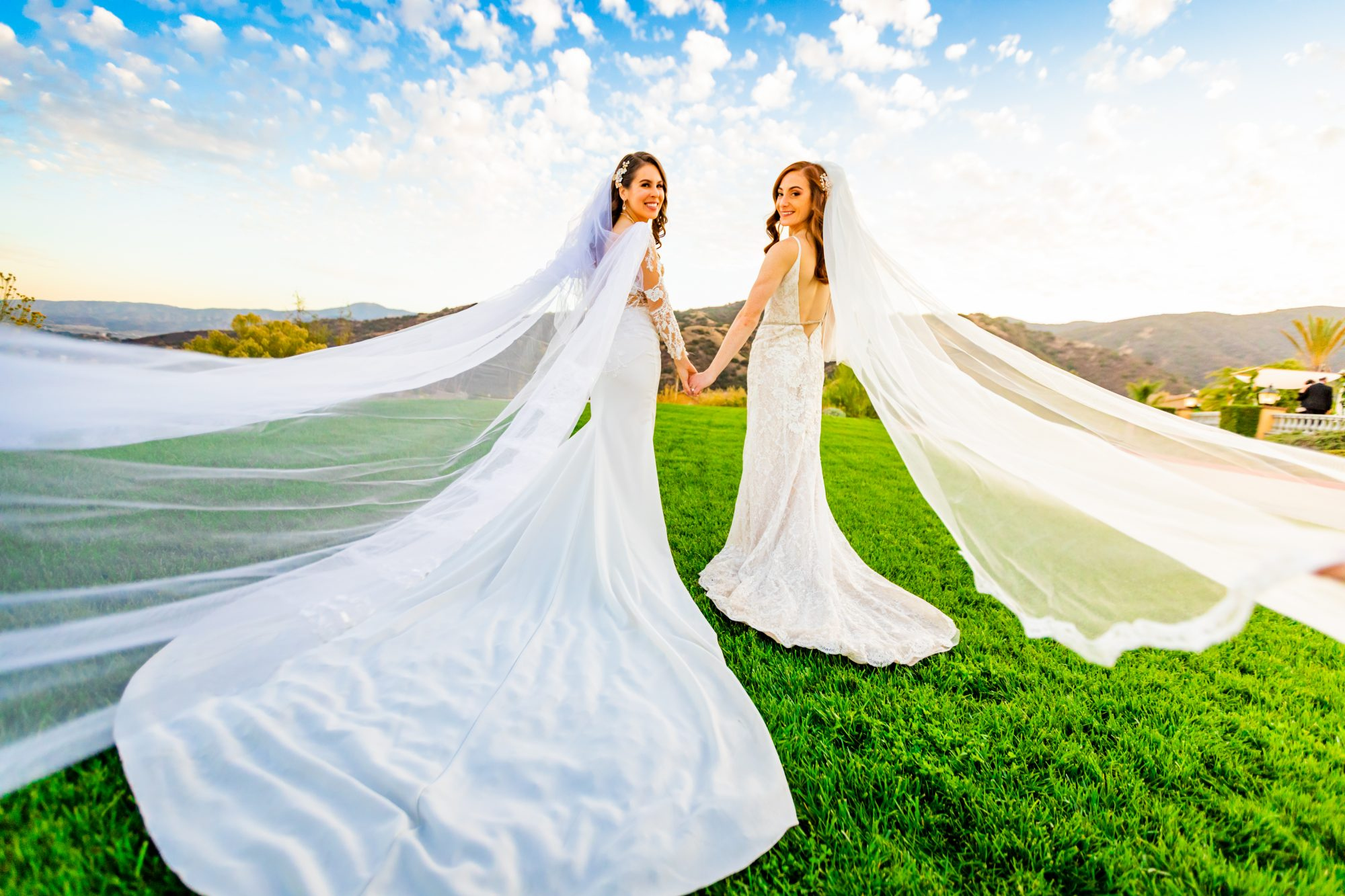 How to Remove Stains from a Wedding Dress, 2 women in white wedding gowns