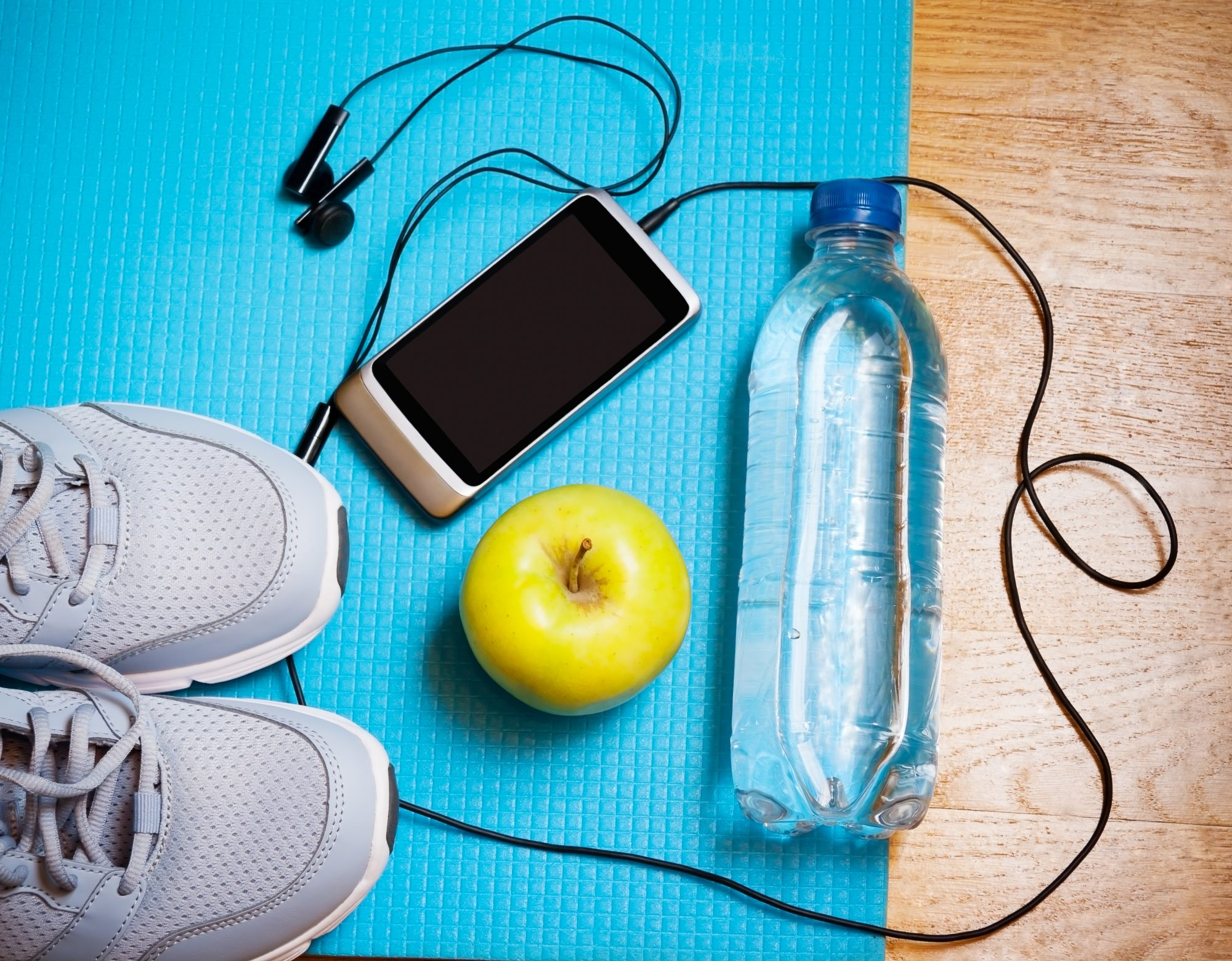 Best Podcasts to Listen to While Going for a Walk: sneakers, phone, headphones