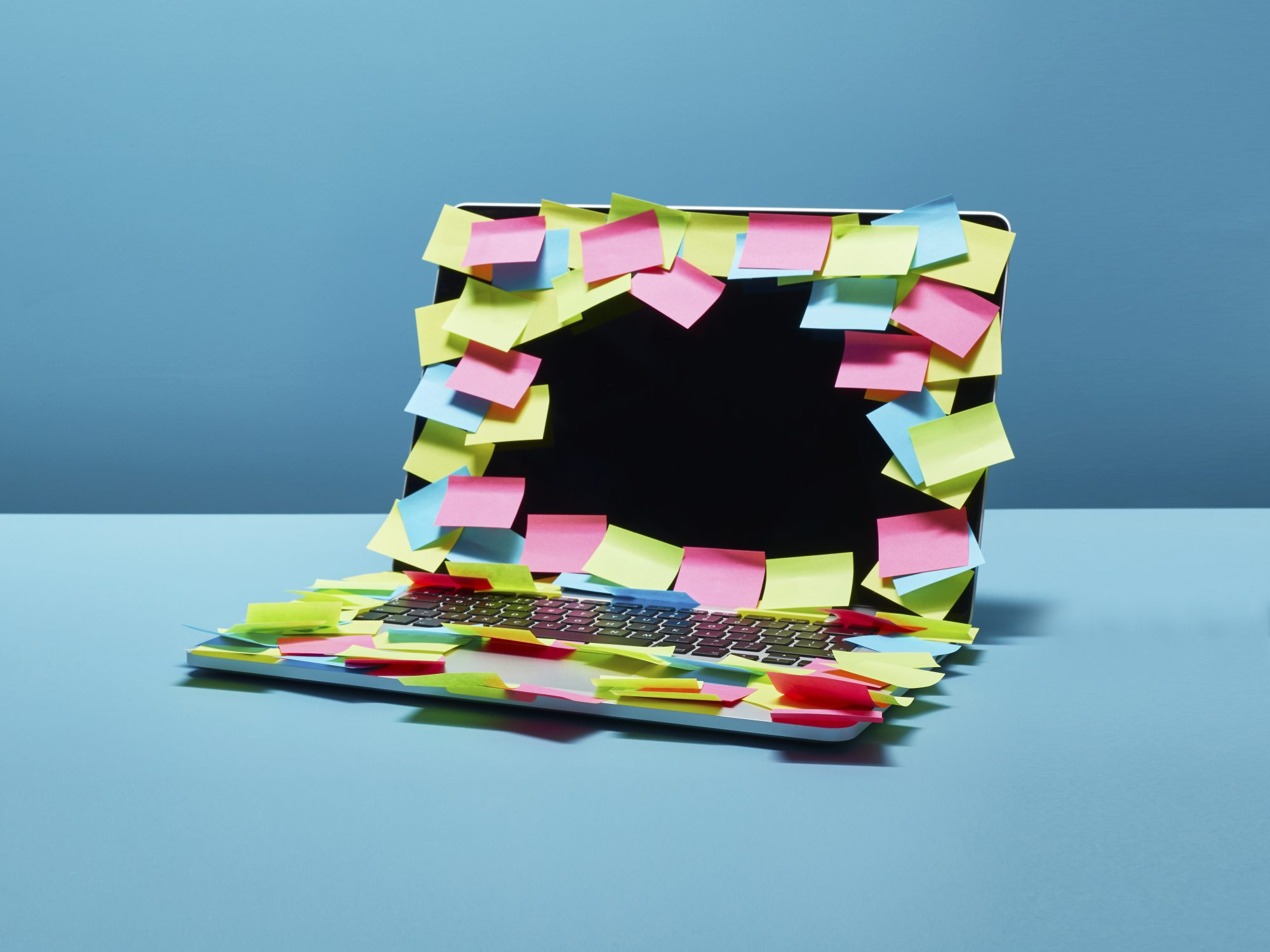 How Anxiety Impacts Work Performance and How to Beat It: laptop with lots of post-its