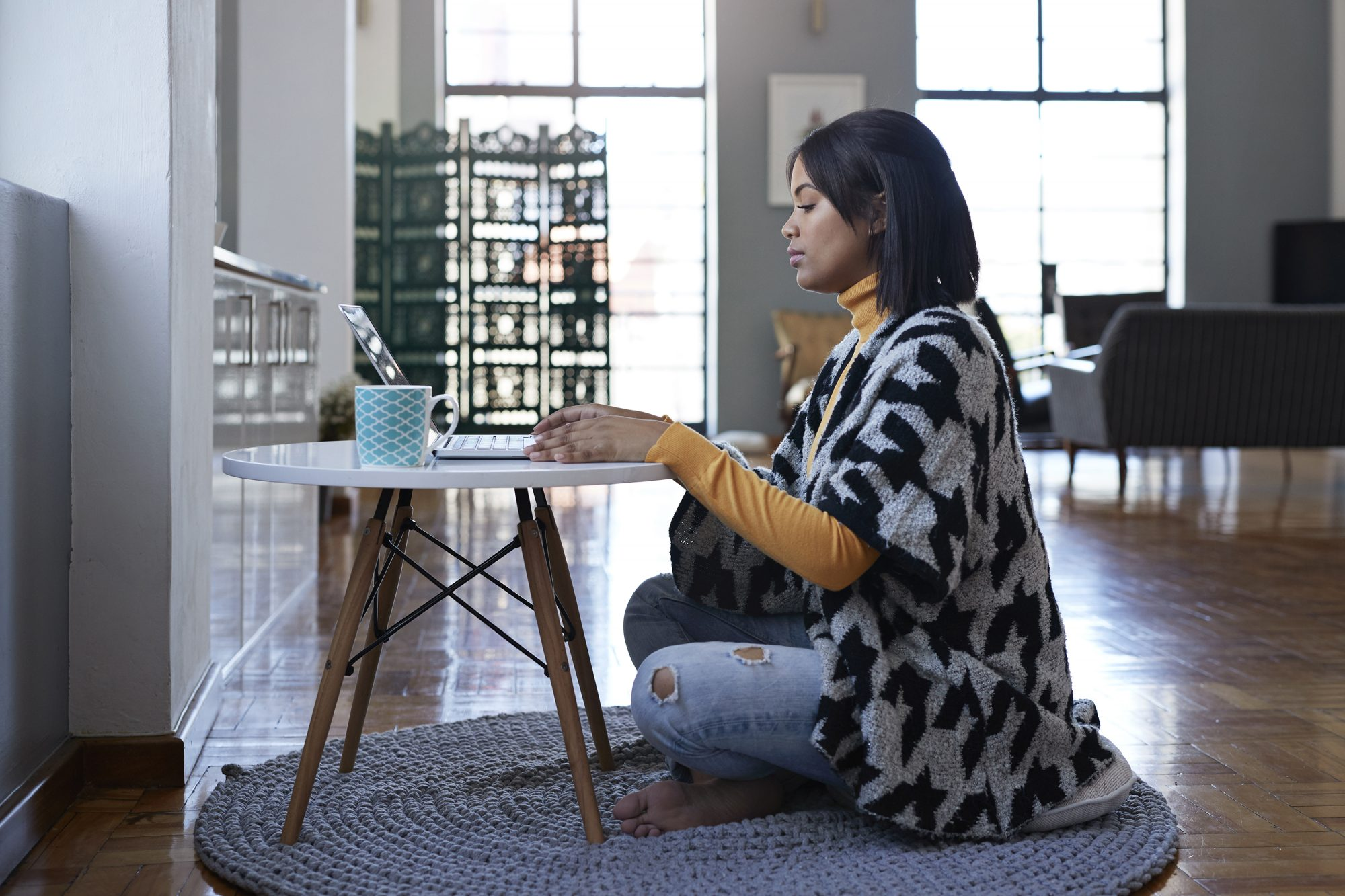How Working From Home Affects Impostor Syndrome—and How to Deal: woman working from home