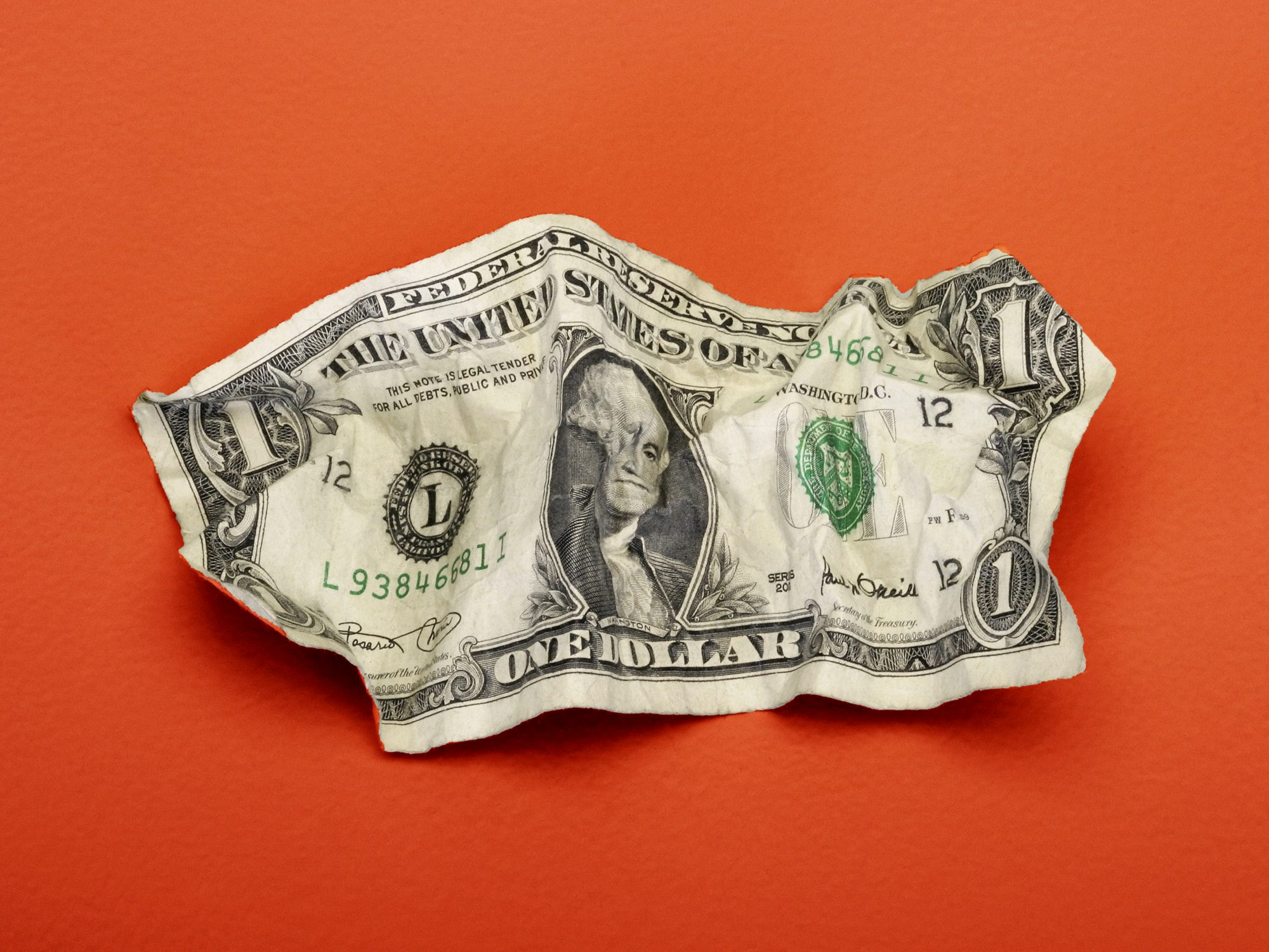 Money-stress: crumpled dollar bill