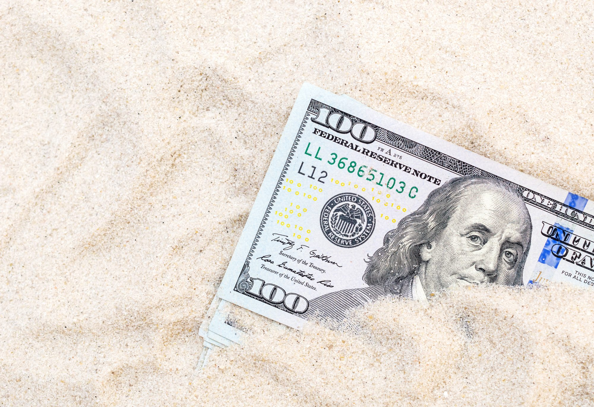 save-money-vacation: cash in the sand
