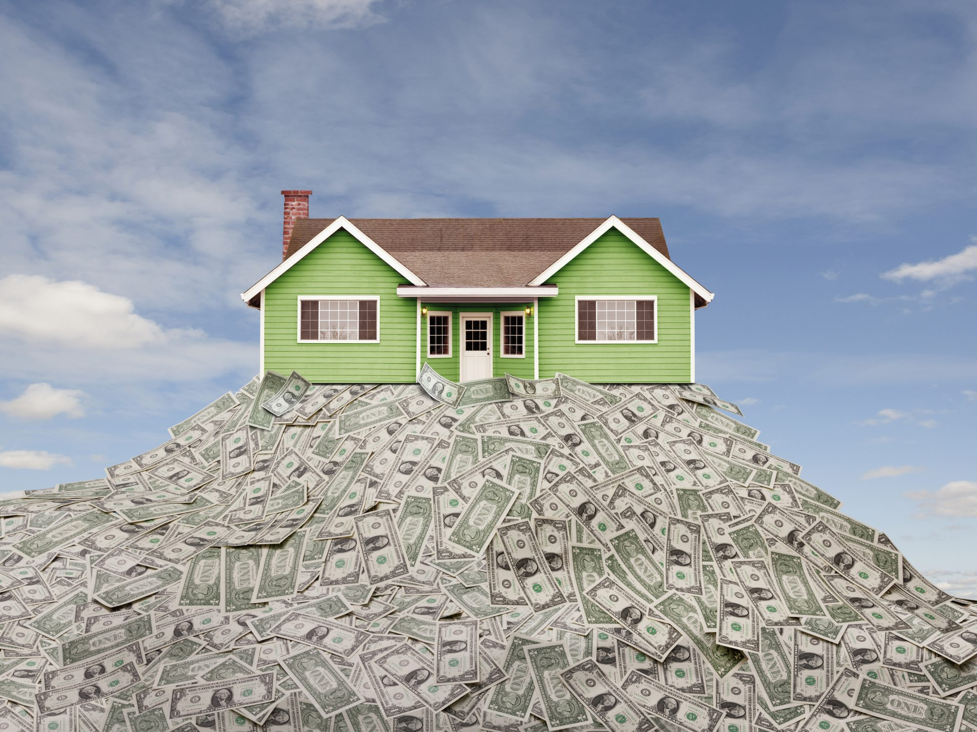 real-estate-investing: house on a pile of money