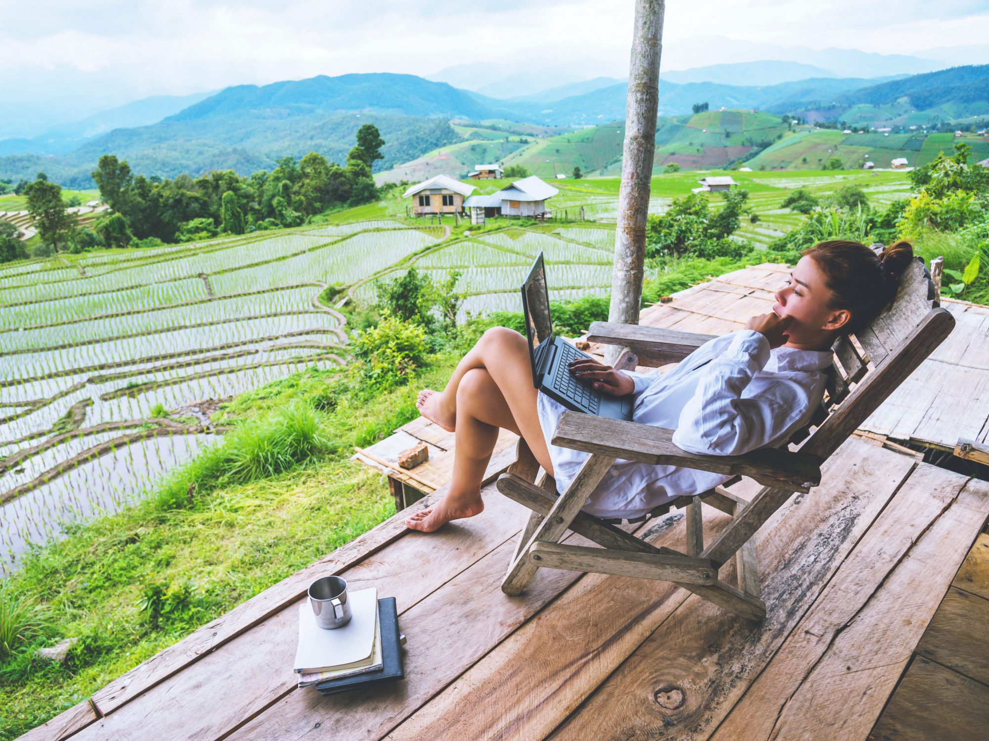 How to Create a Work From Outdoors Setup: woman working outdoors