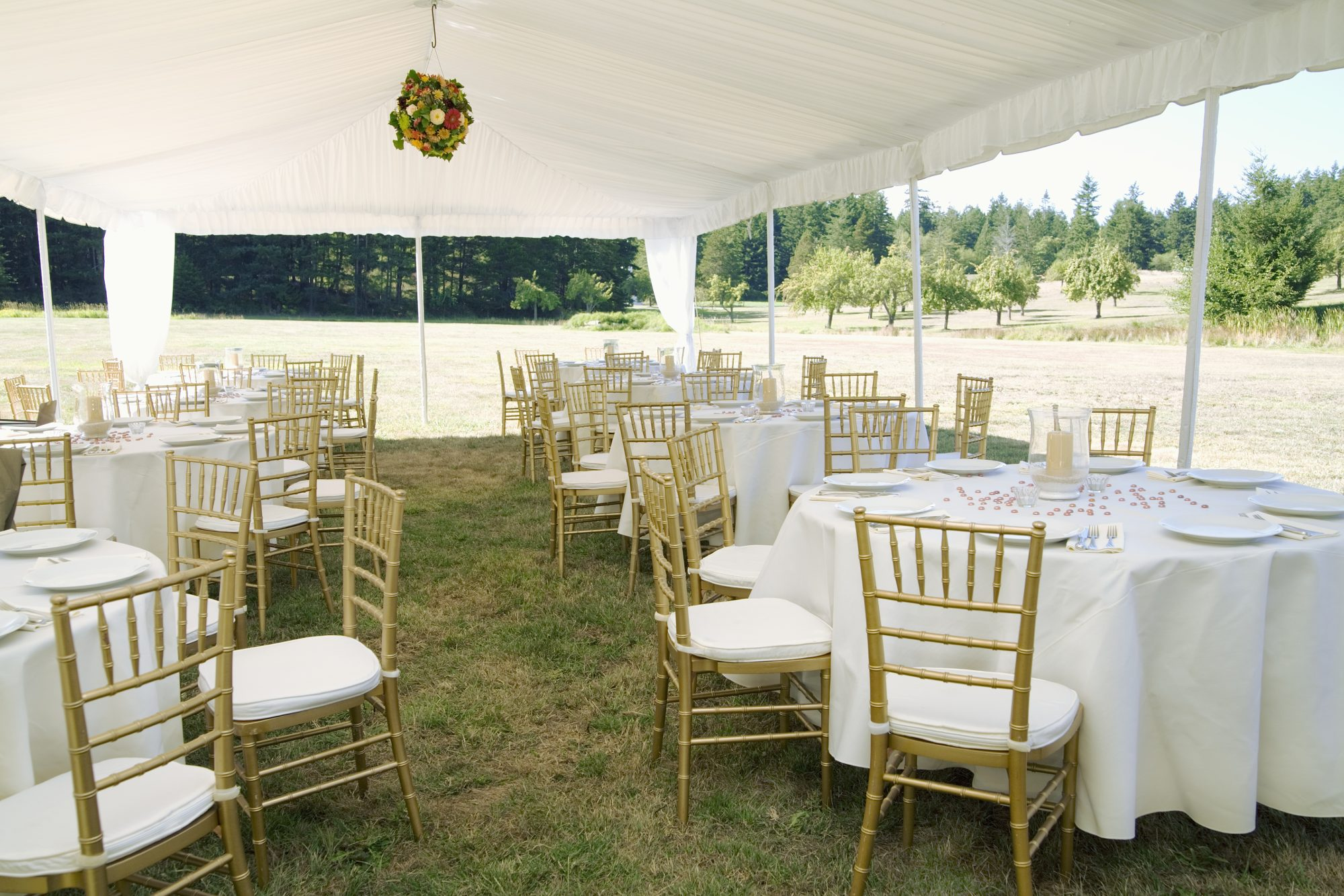 How to Plan a 2021 Wedding, According to Experts: tables and chairs in an outdoor tent