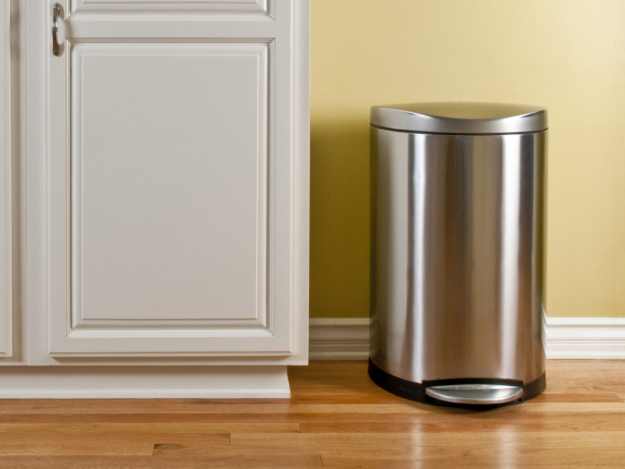 how-clean-How to Clean a Garbage Can: stainless steel garbage can in kitchen