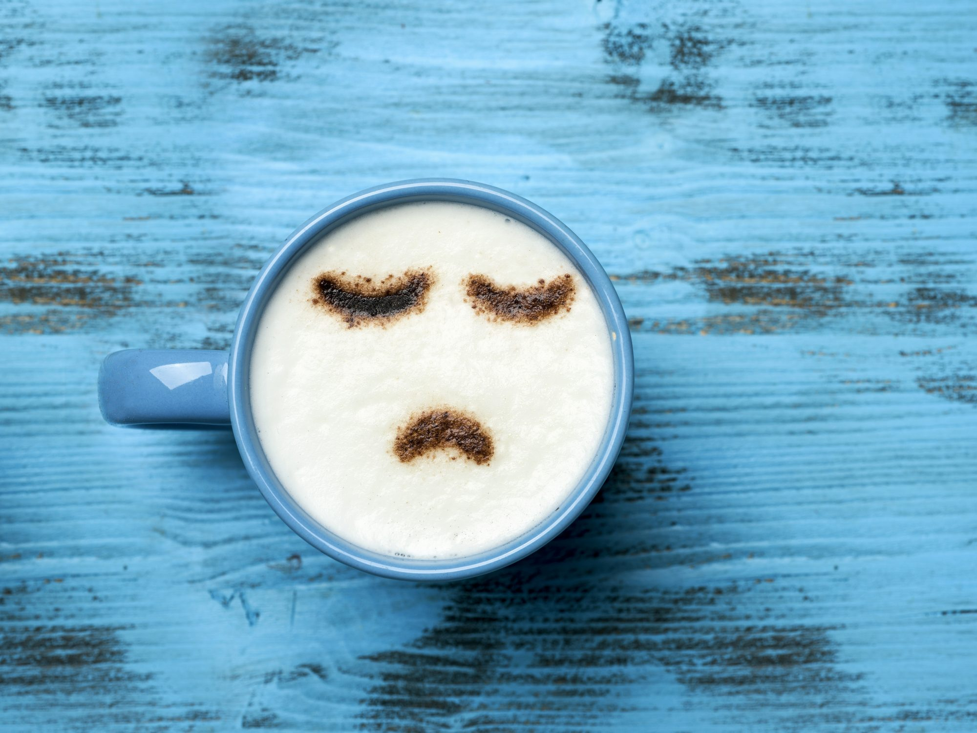 How to Ask Your Boss for a Mental Health Day: coffee cup/sad face