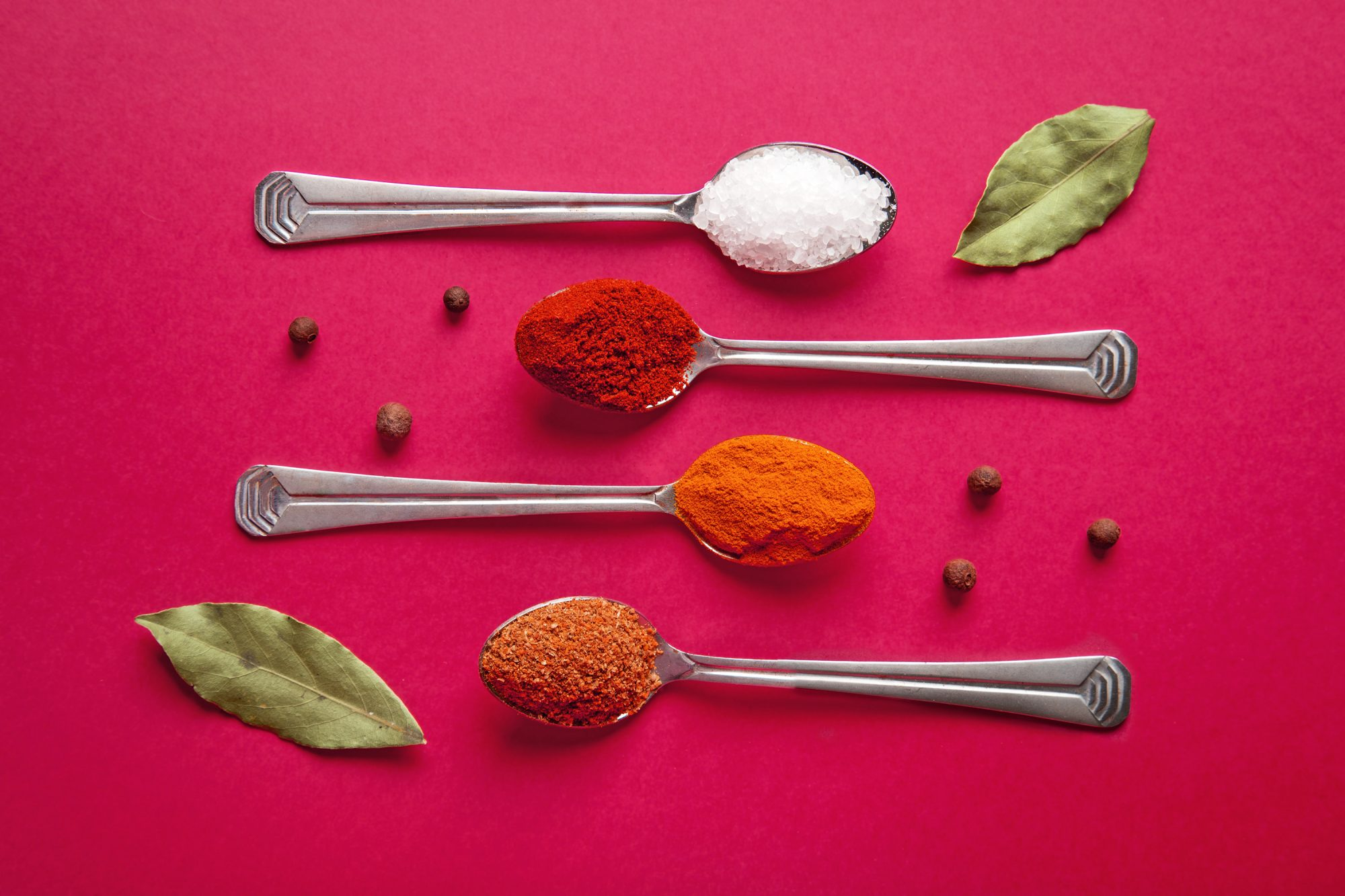 spices-you-need: assorted spices on spoons