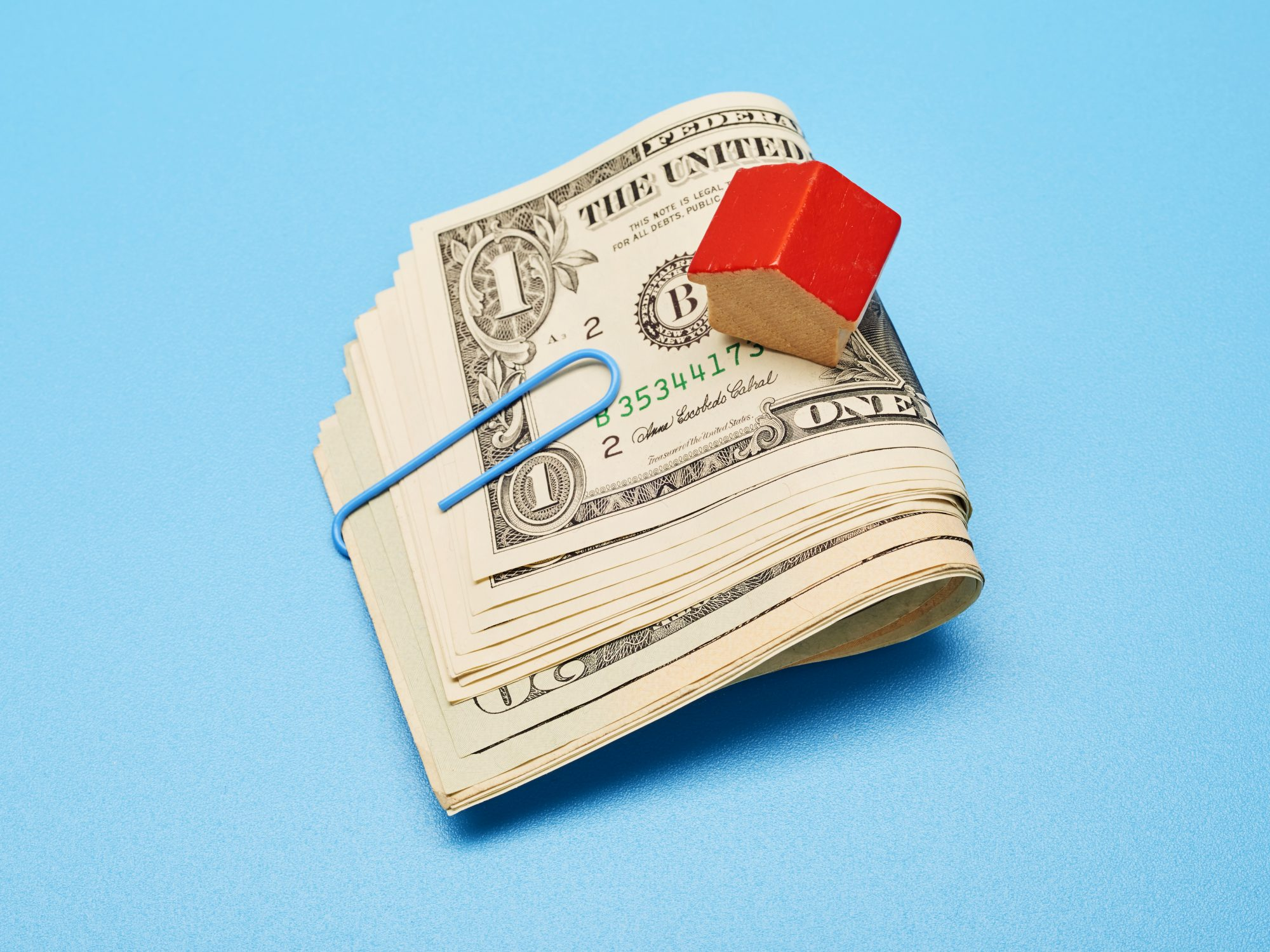 low-mortgage-rates: cash and a toy house