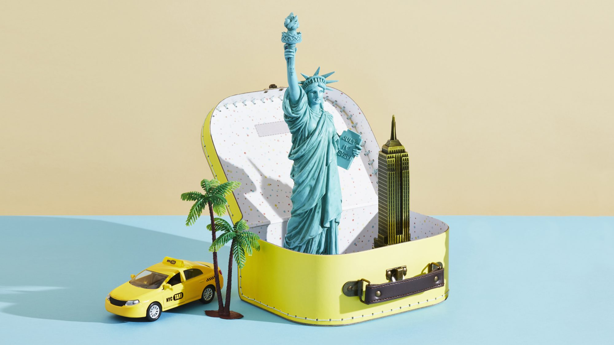 5 Regional Road Trips to Take in the US: suitcase, Statue of Liberty
