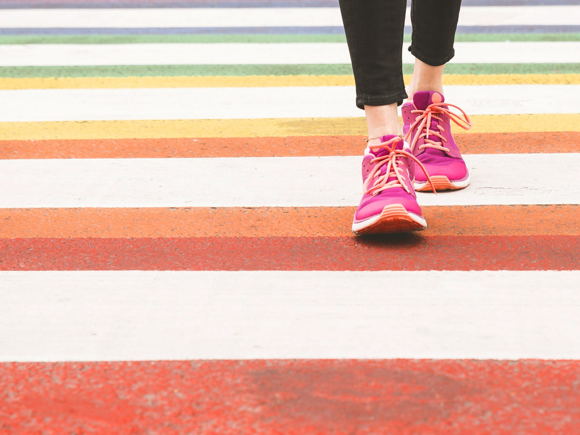 But Why 10,000 Steps? Here's Where This Daily Fitness Goal Comes From—and If It's Really Worth Heeding: pink sneakers walking