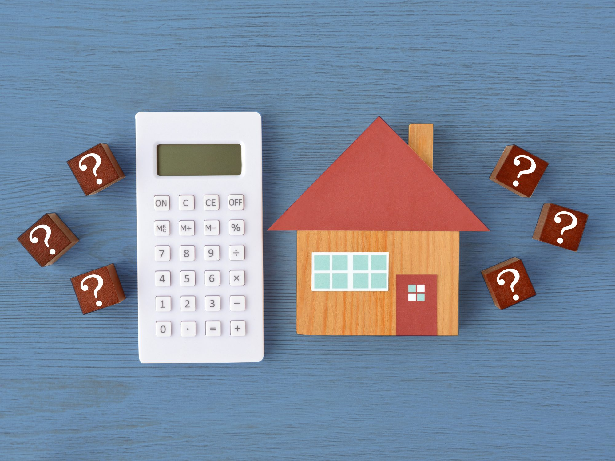 home-buying: calculator and toy home