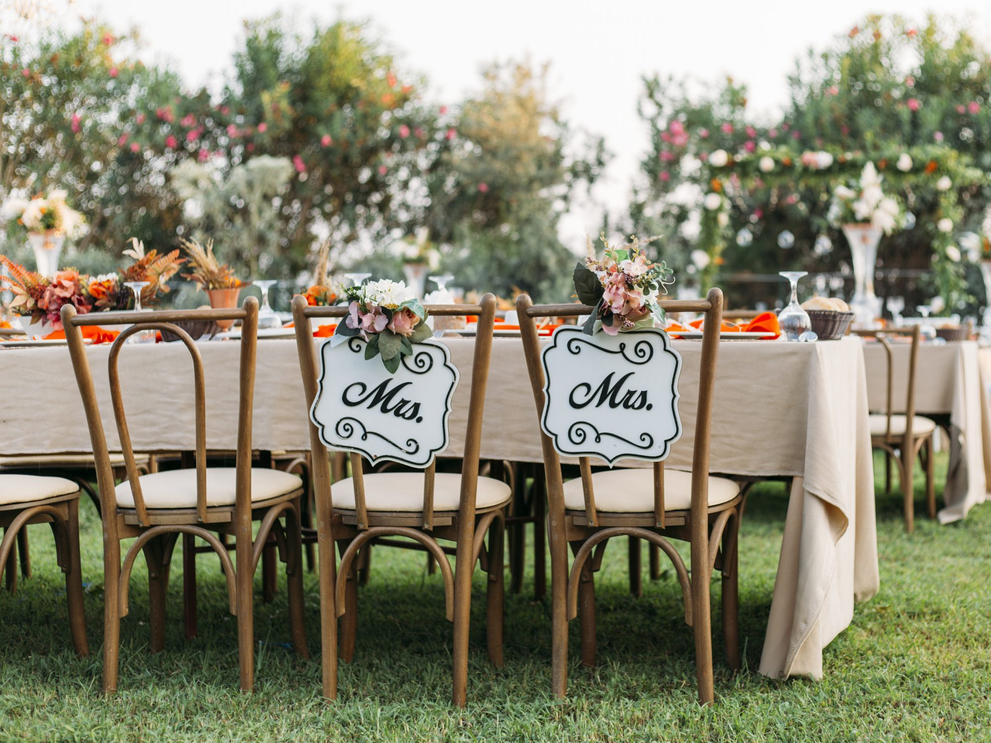 How to Budget as a 2021 Wedding Guest, money-saving tips: Bride and Groom Chair at Wedding Reception