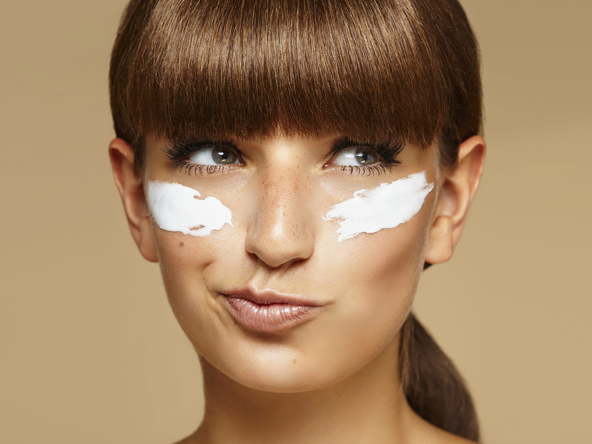 difference-between-eye-cream-and-moisturizer: woman with eye cream