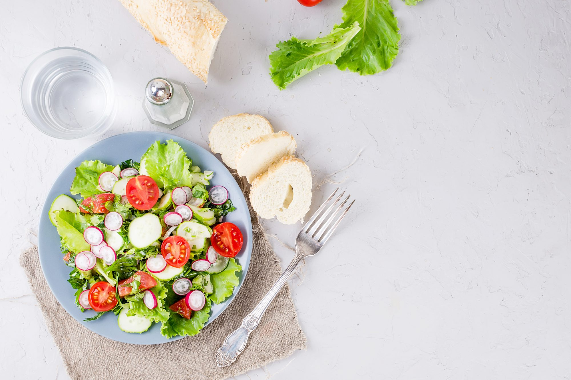 Lunch salad on a plate with bread