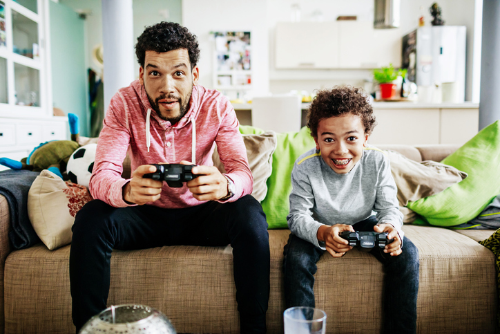 Father and Son Playing Video Games on a Rainy Day