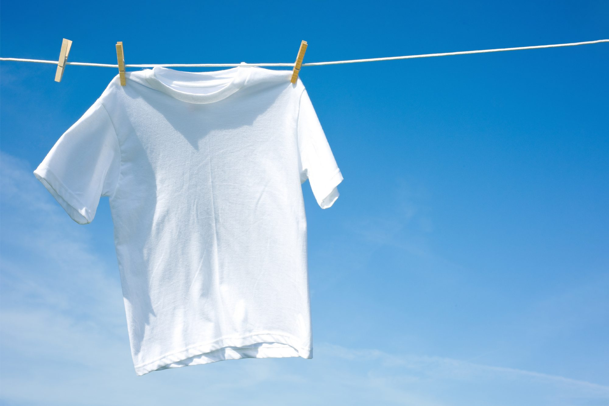 Ways to Whiten Laundry Without Bleach, white t-shirts drying outside
