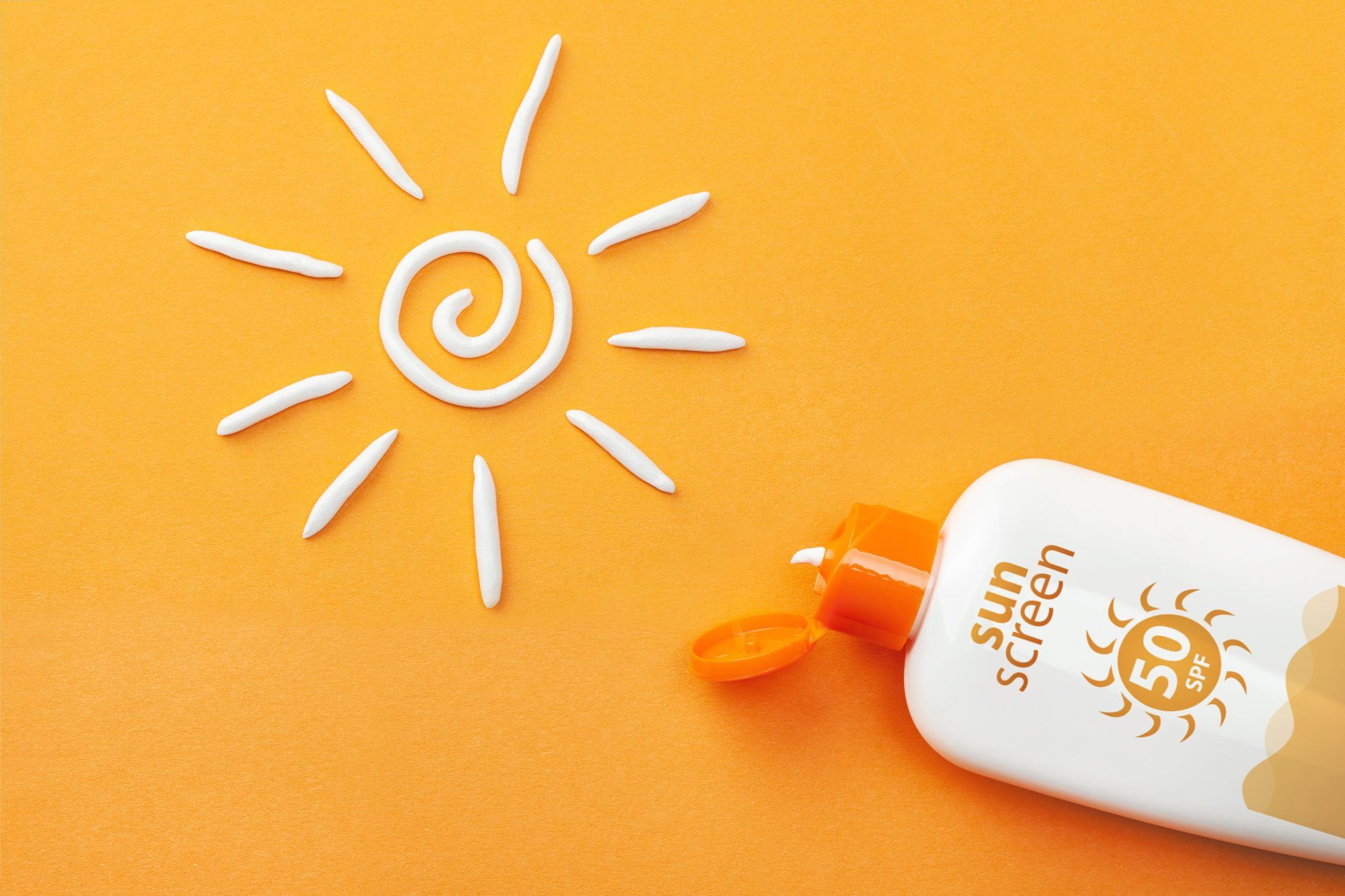 how-to-apply-sunscreen: bottle of sunscreen and lotion in shape of sun