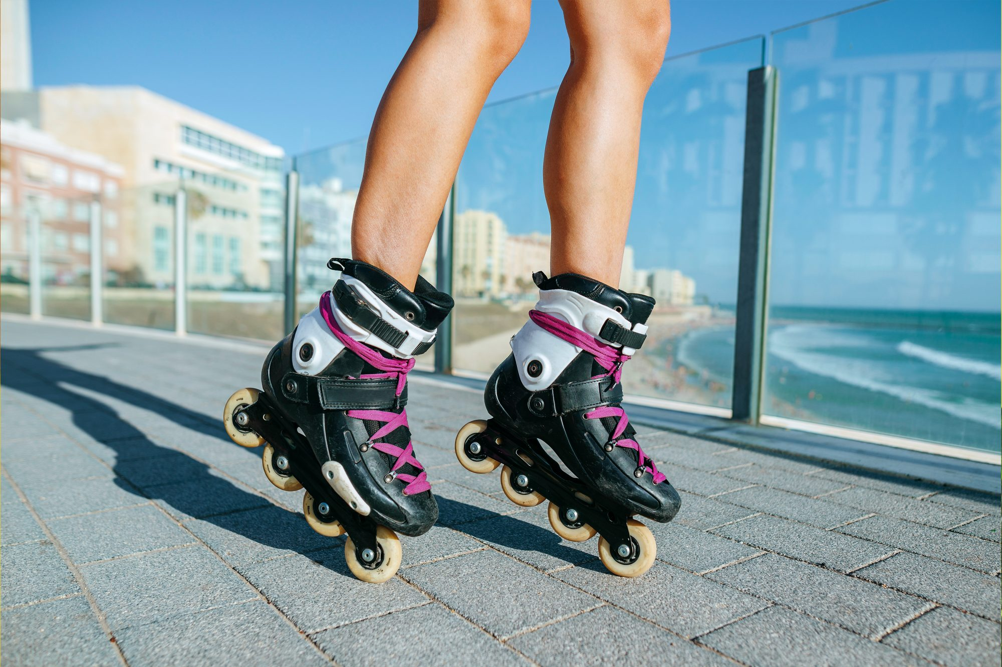 Rollerblading inline skating health and wellness benefits, safety tips, beginner tips: woman wearing inline skates
