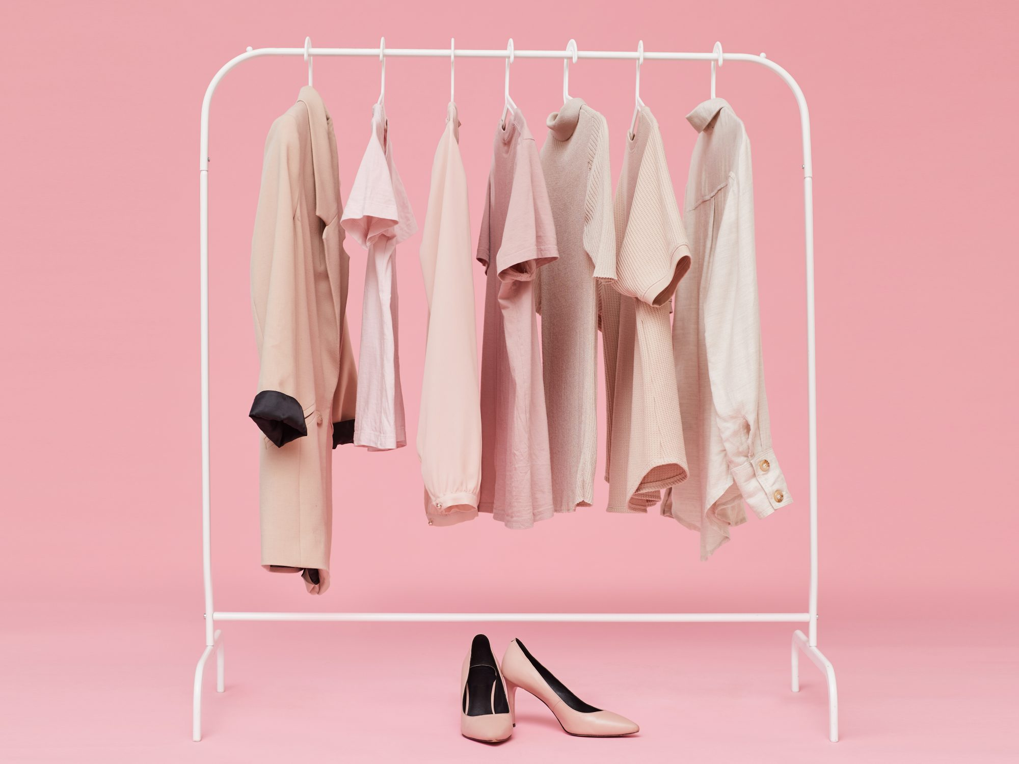how-to-get-excited-about-your-clothes-again: rack of clothes