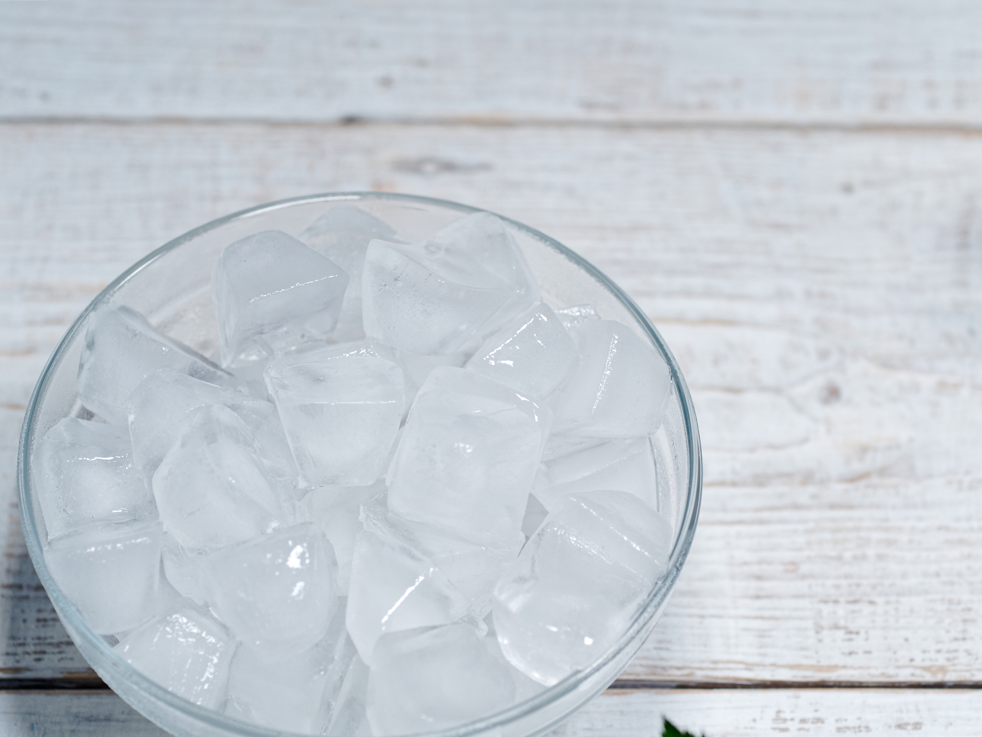 If it's hot but not humid, place a shallow bowl of ice in front of a fan and enjoy the breeze. As the ice melts, then evaporates, it will cool you off.