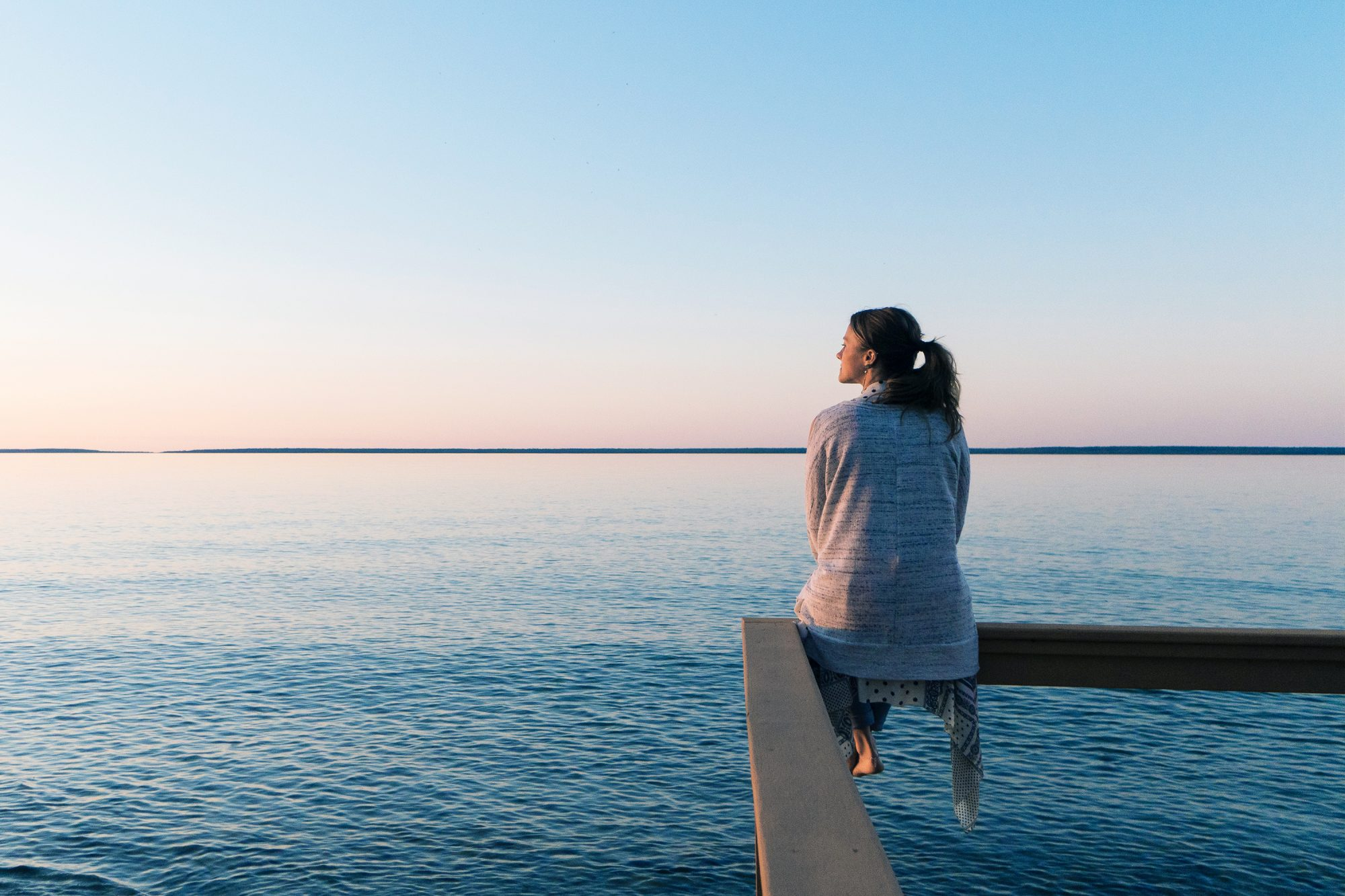 Mental Health Benefits of Being Near Water: woman gazing out at the water