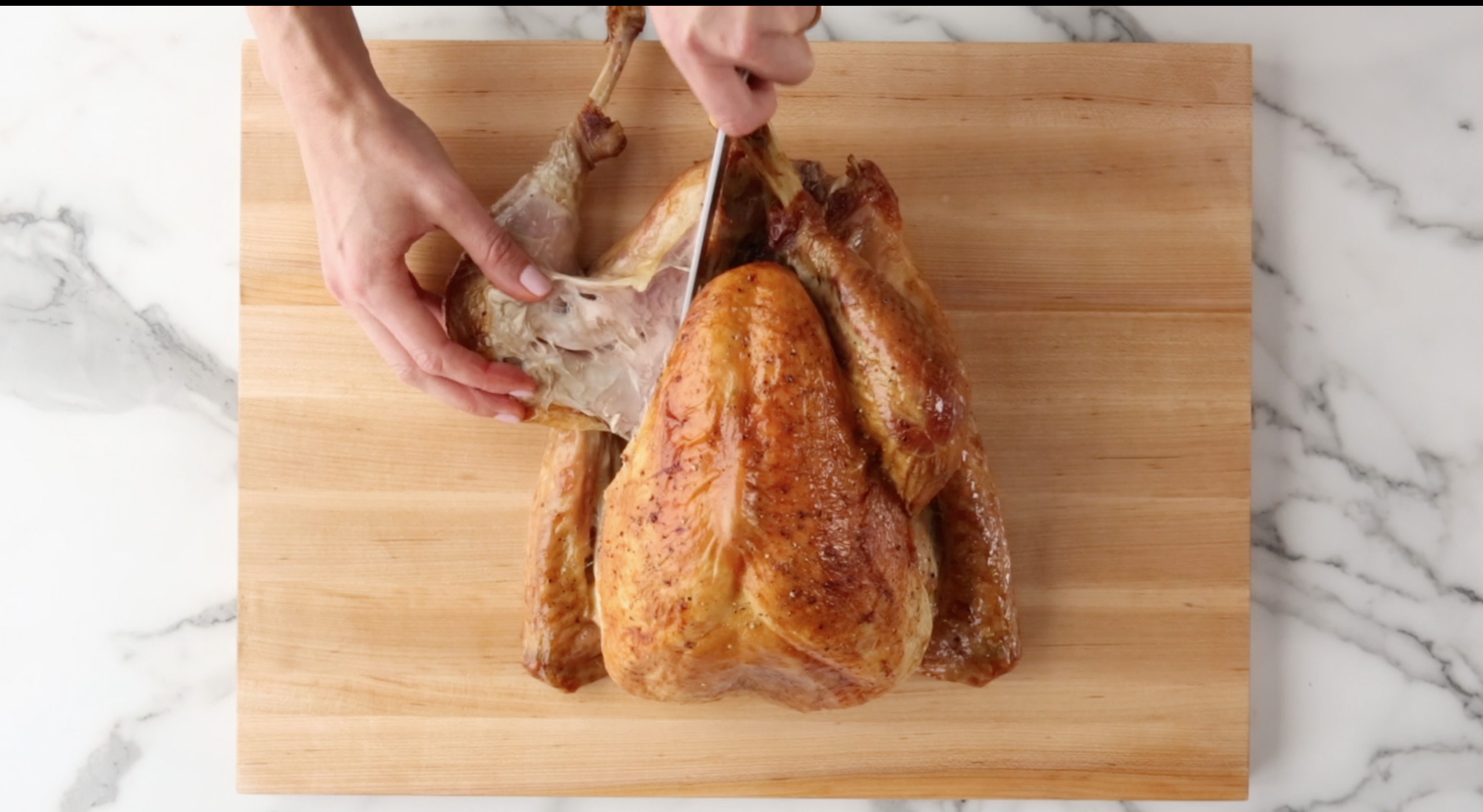 Remove legs and thighs on a turkey