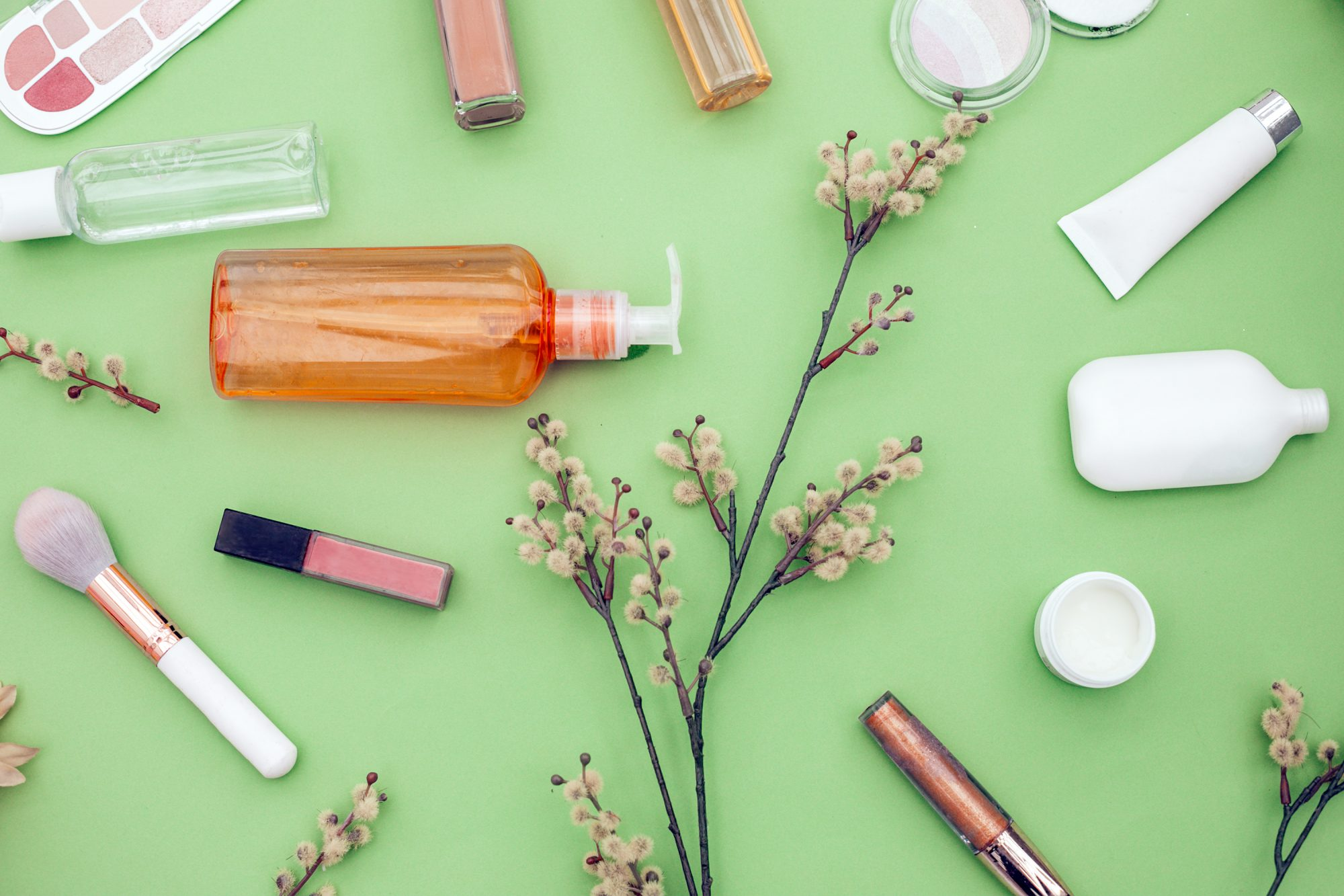 natural cosmetics on green backround