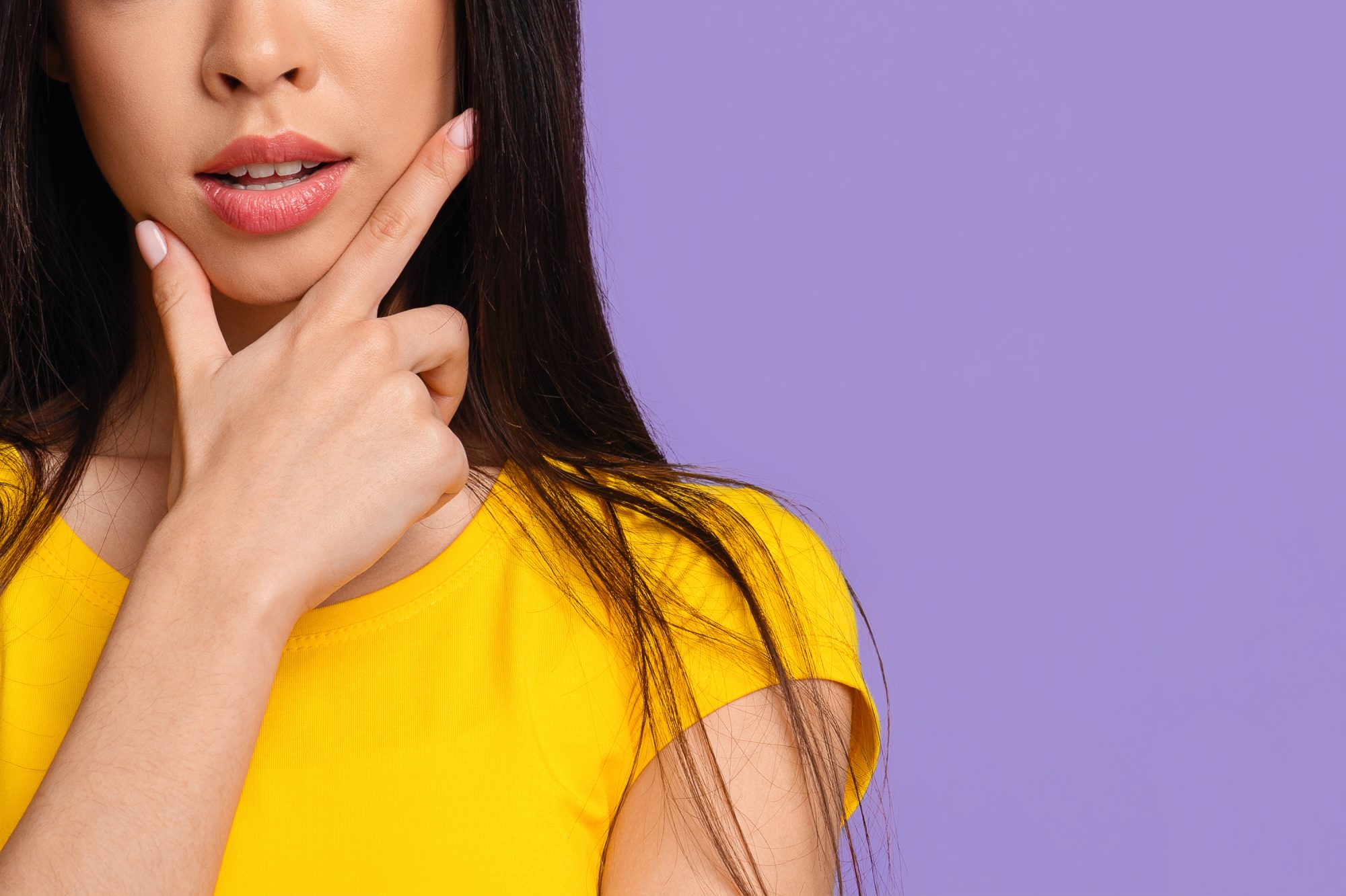 How to Stop Touching Your Face So Much: woman touching her face