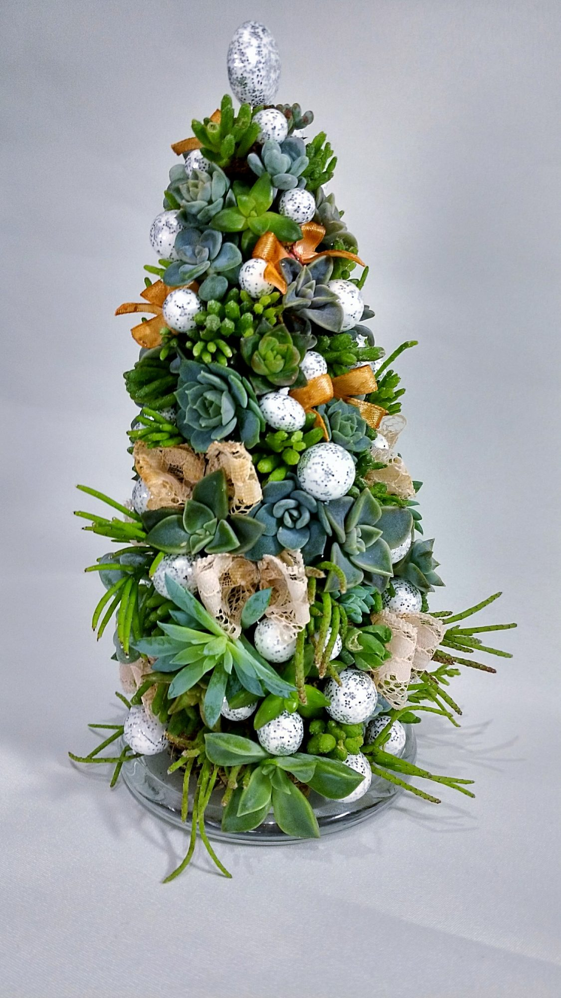 Find a cone-shaped planting form, or use faux succulents and hot glue (plus a few choice ornaments) to create this unique tree.