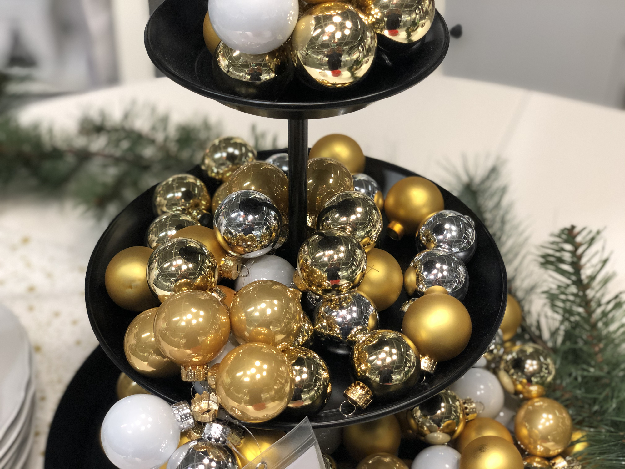 Rather than putting sweets and treats on your favorite tiered tray, load it up with pretty Christmas ball ornaments for a festive tree-like centerpiece.