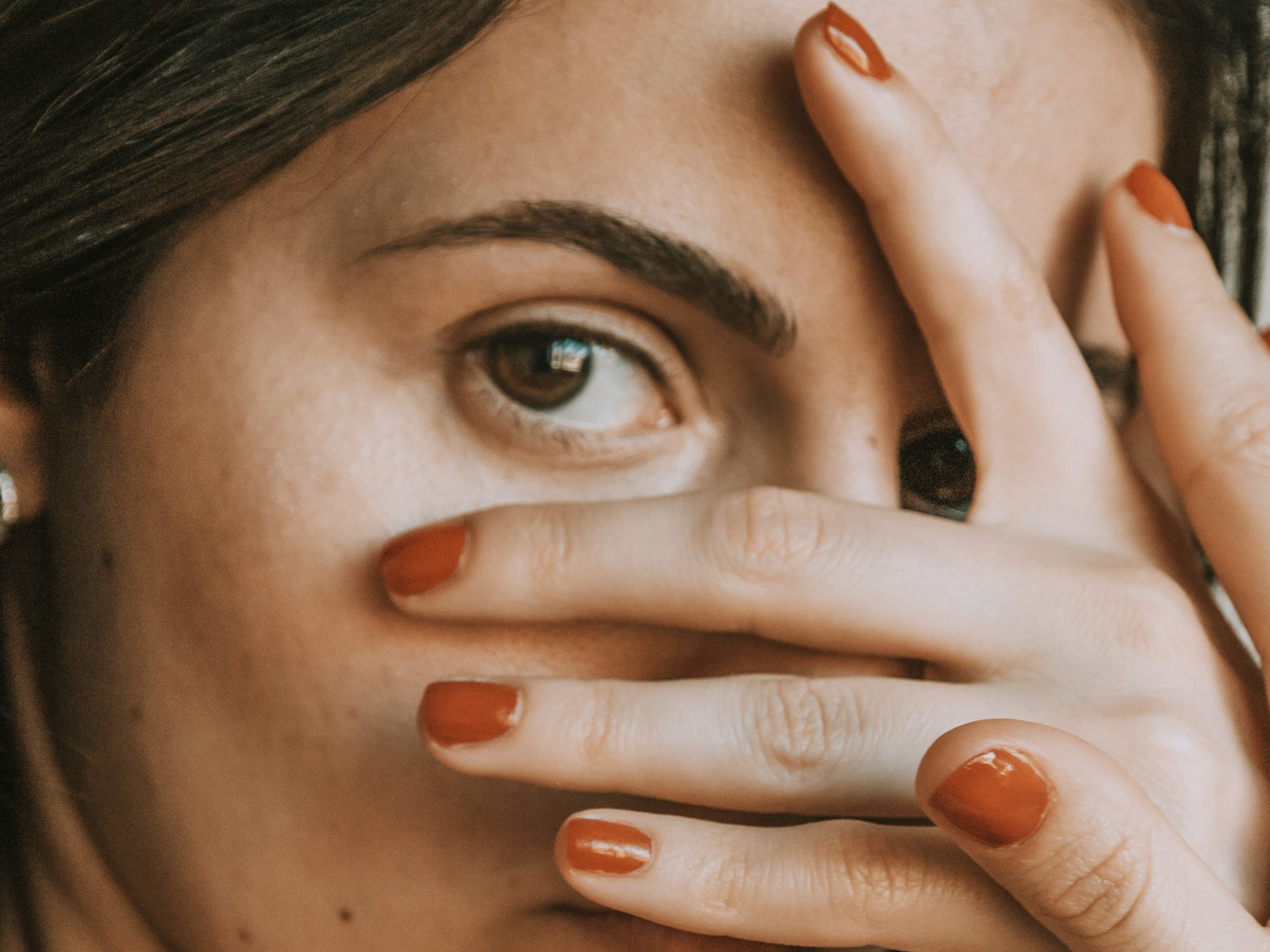 how-to-avoid-acne: woman covering her face