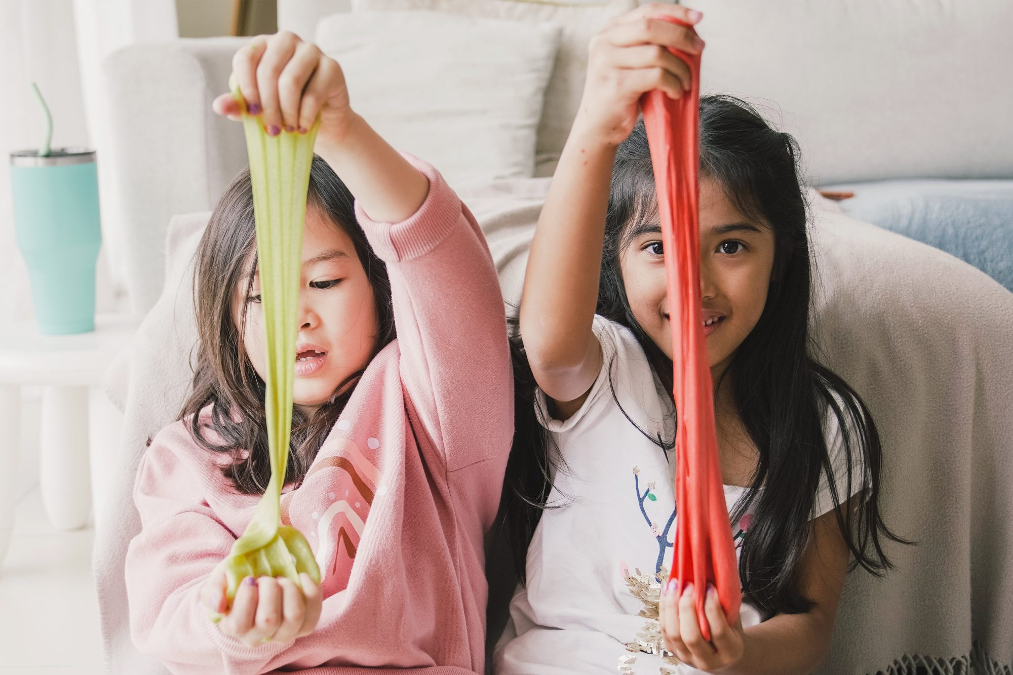 kids playing with colored slime