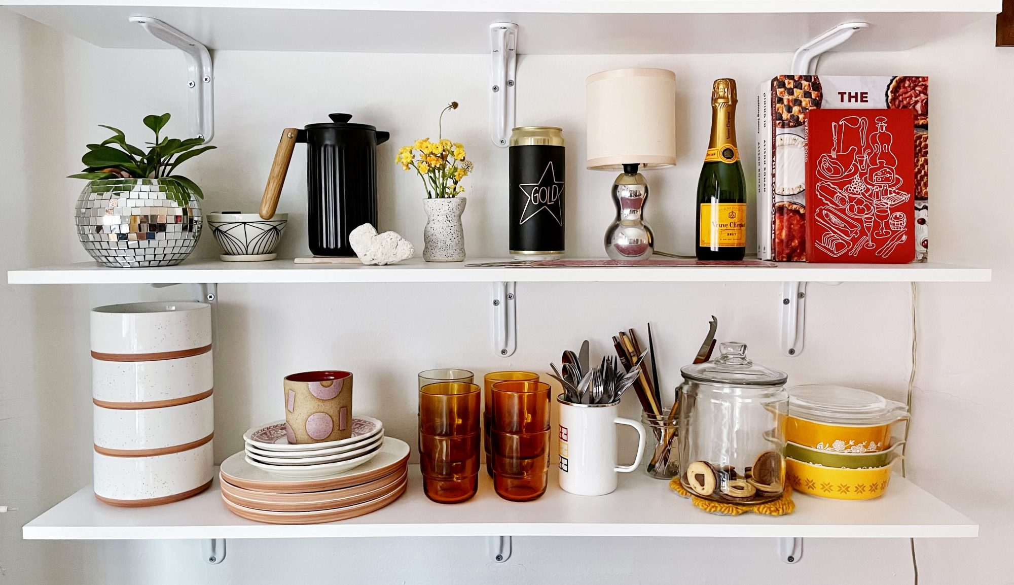 white shelves with various kitchen items
