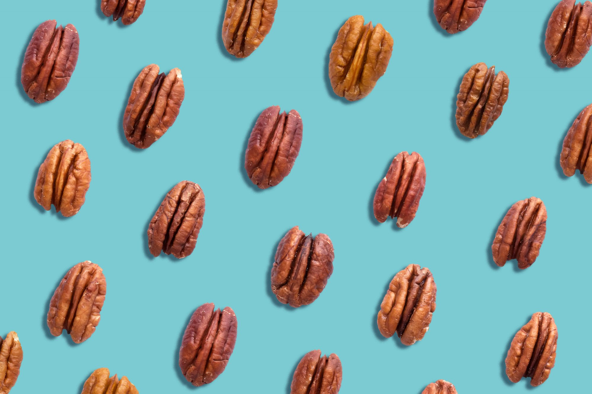 Pecans Nutrition: pecan nuts on a blue background