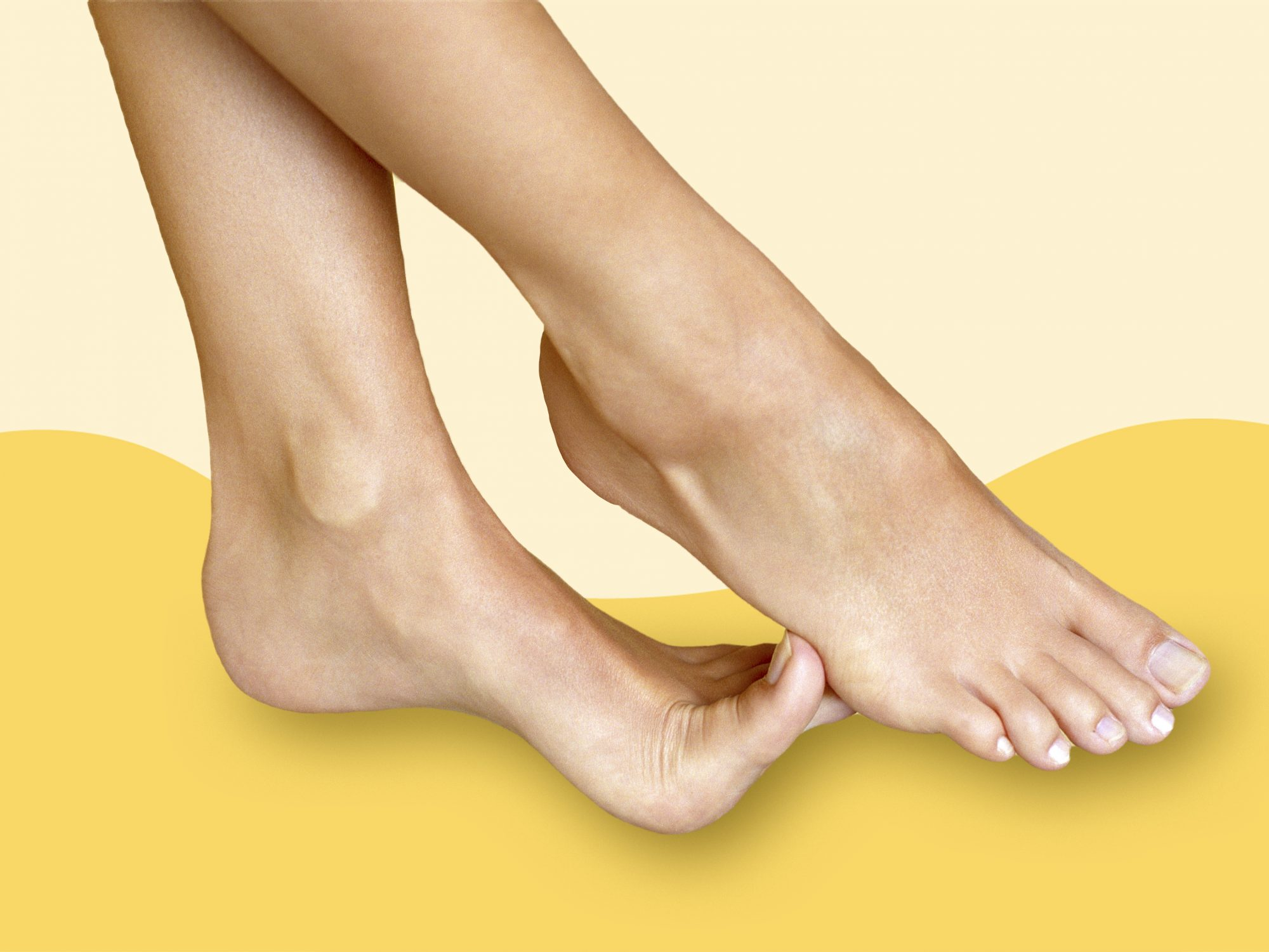 How to Relieve Toe Cramps: cramped foot on yellow background