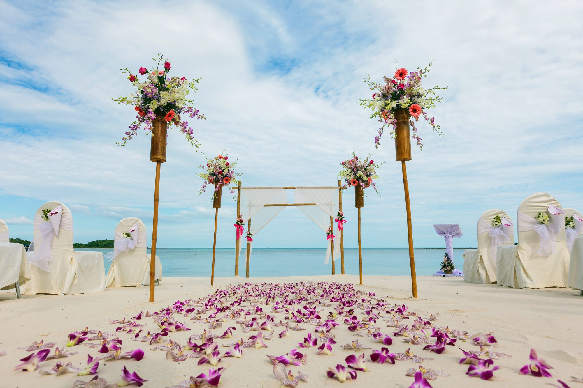 wedding on a beach with exotic flowers