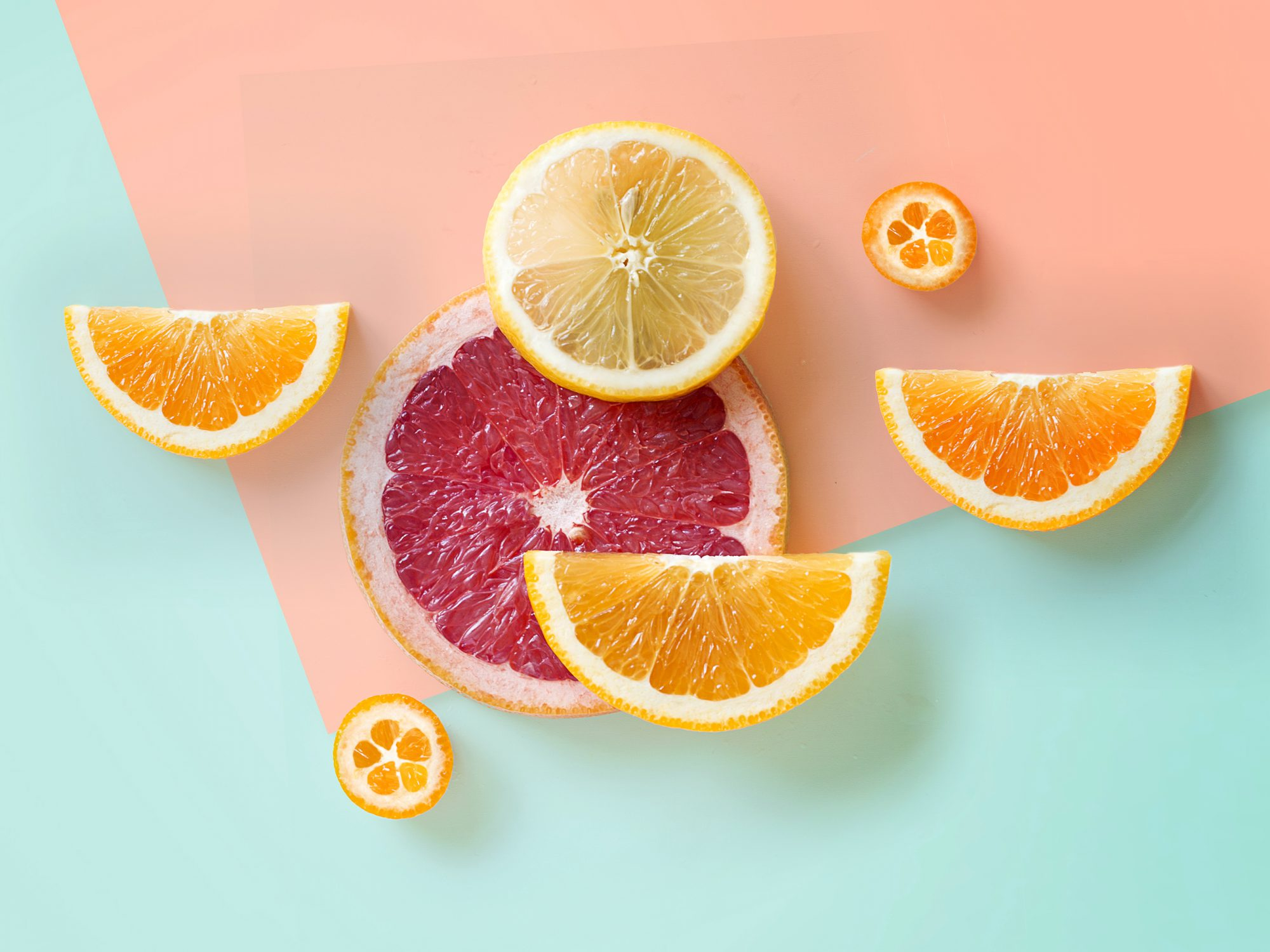 slices of oranges and grapefruit on a colorful background
