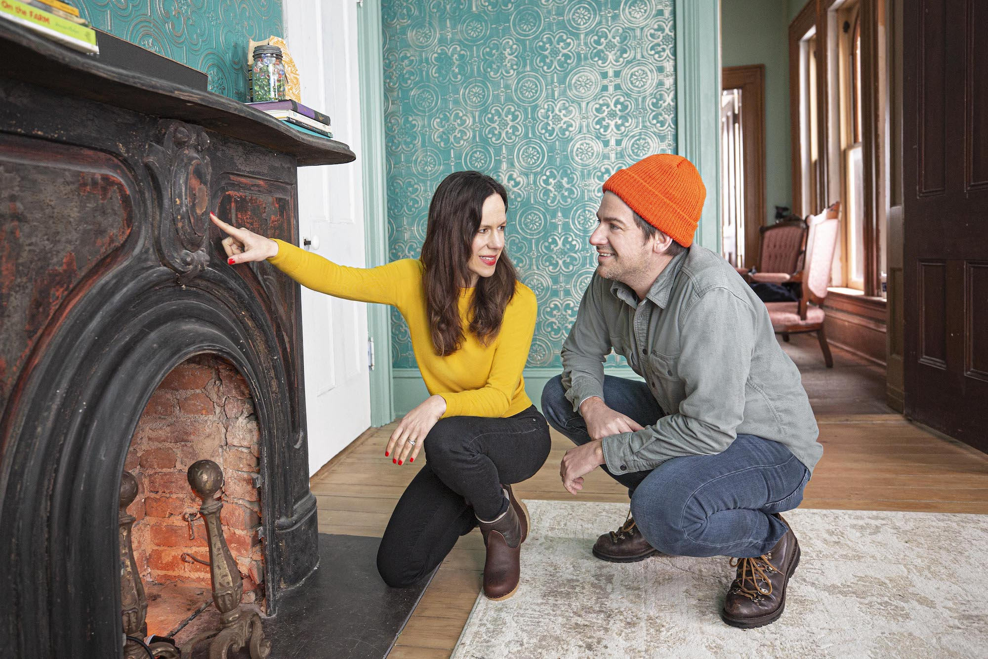 Cheap Old Houses TV Show, checking fireplace