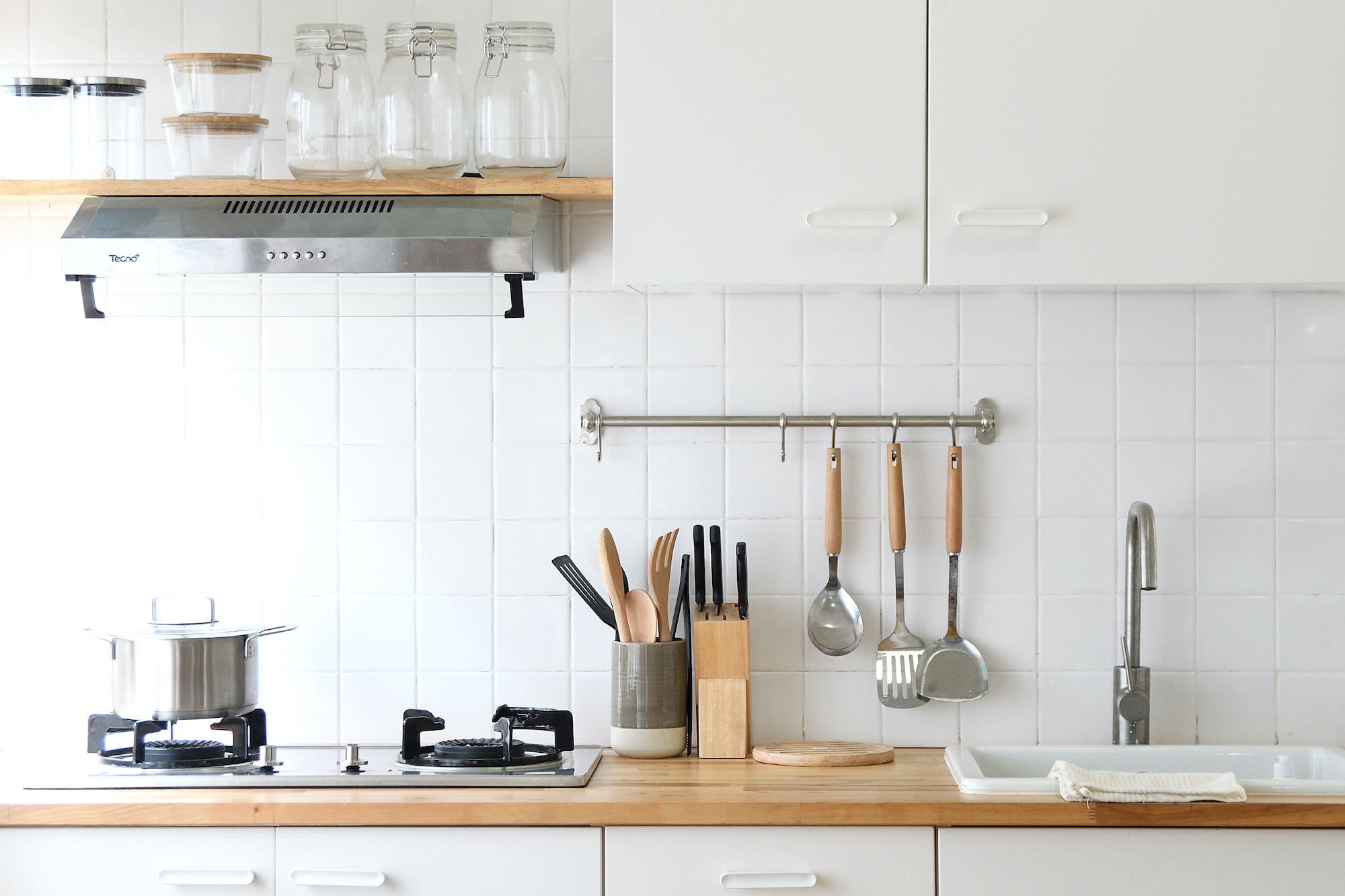 Kitchen with hanging storage and canisters