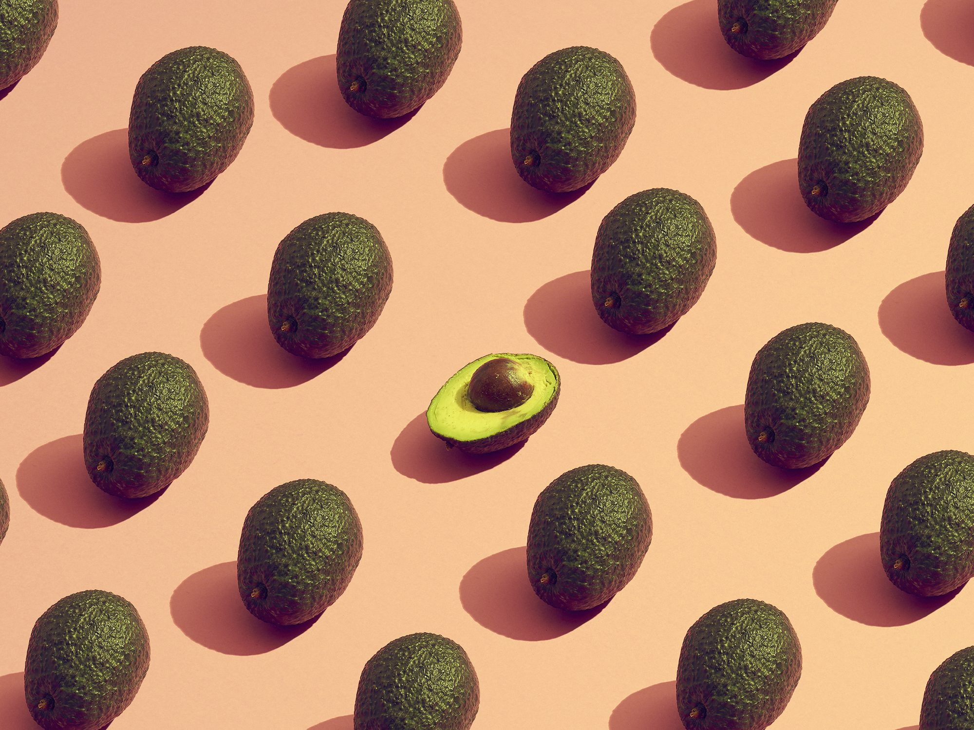 Healthy fats: large group of avocados placed in a pattern