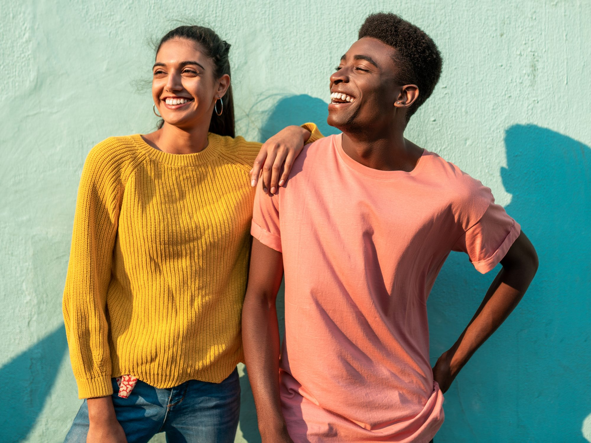 Portrait of two smiling couple looking away