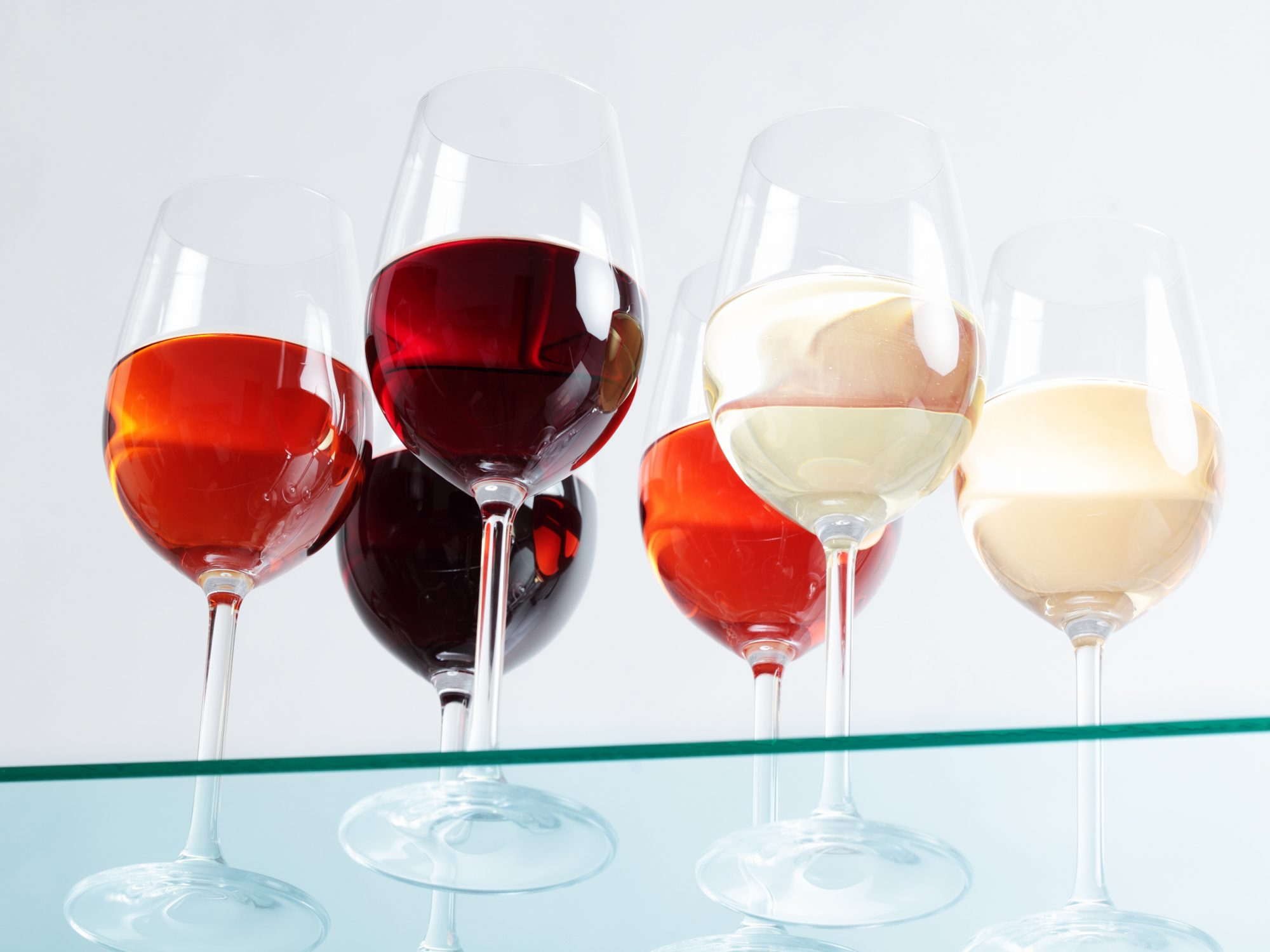 wine glasses seen from under the bar