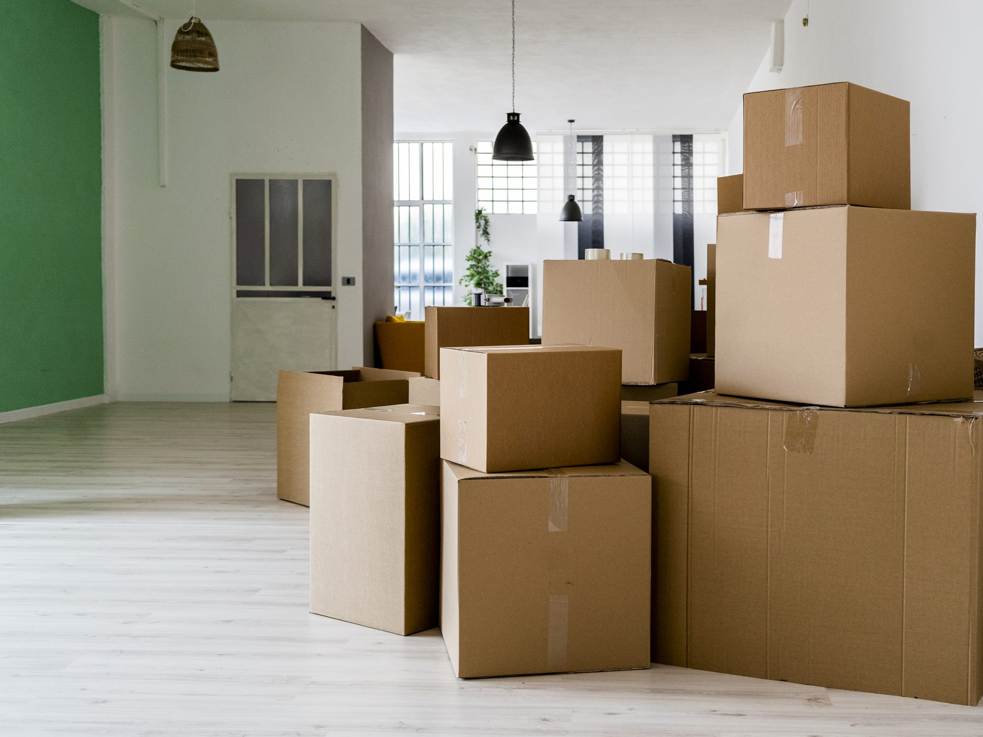 Carboard boxes in living room of new house